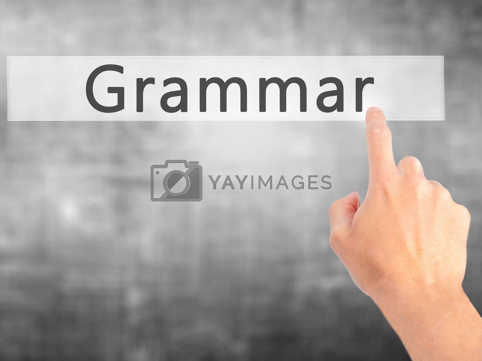 Grammar - Hand pressing a button on blurred background concept o by jackald
