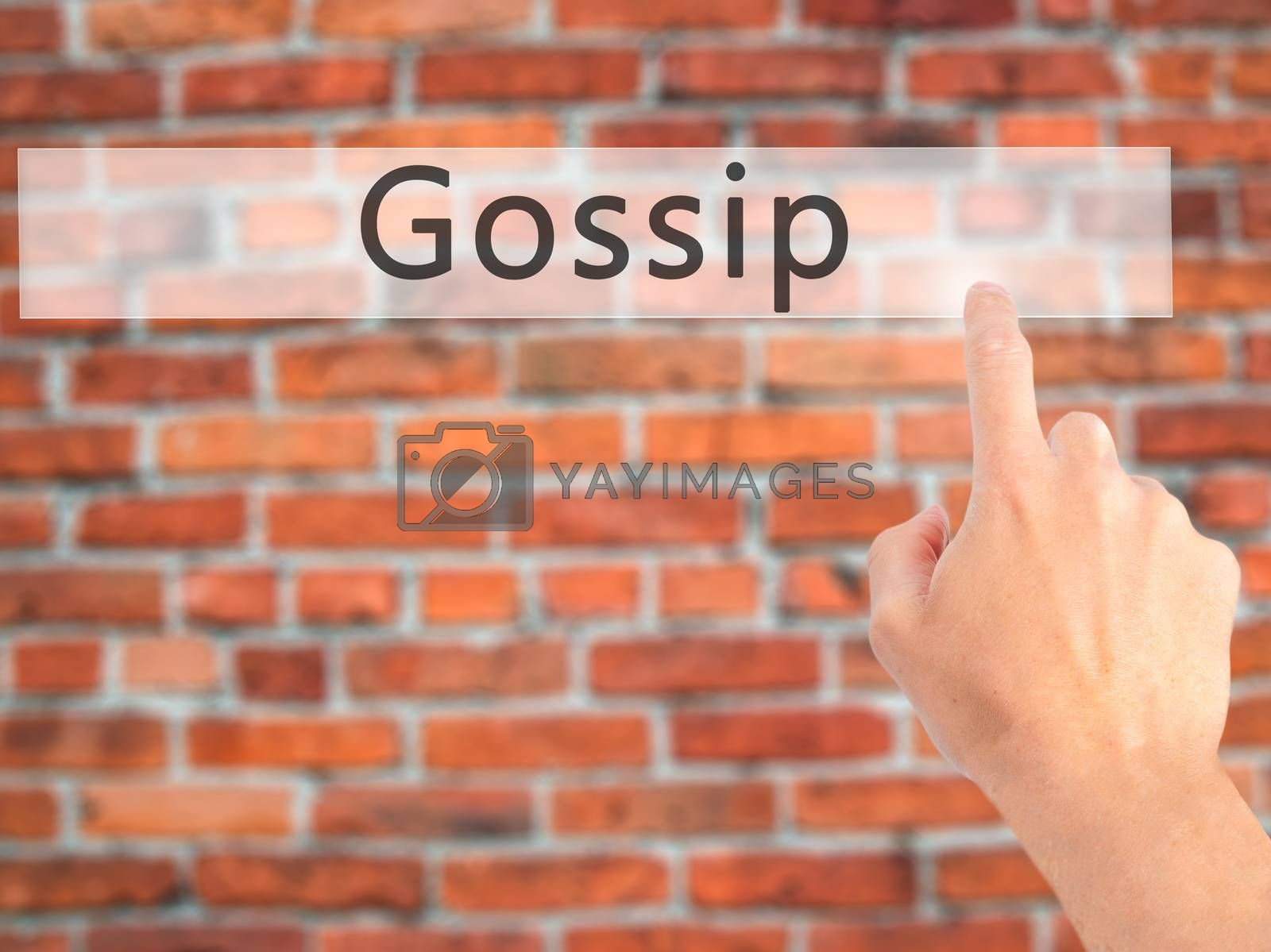 Gossip - Hand pressing a button on blurred background concept on by jackald