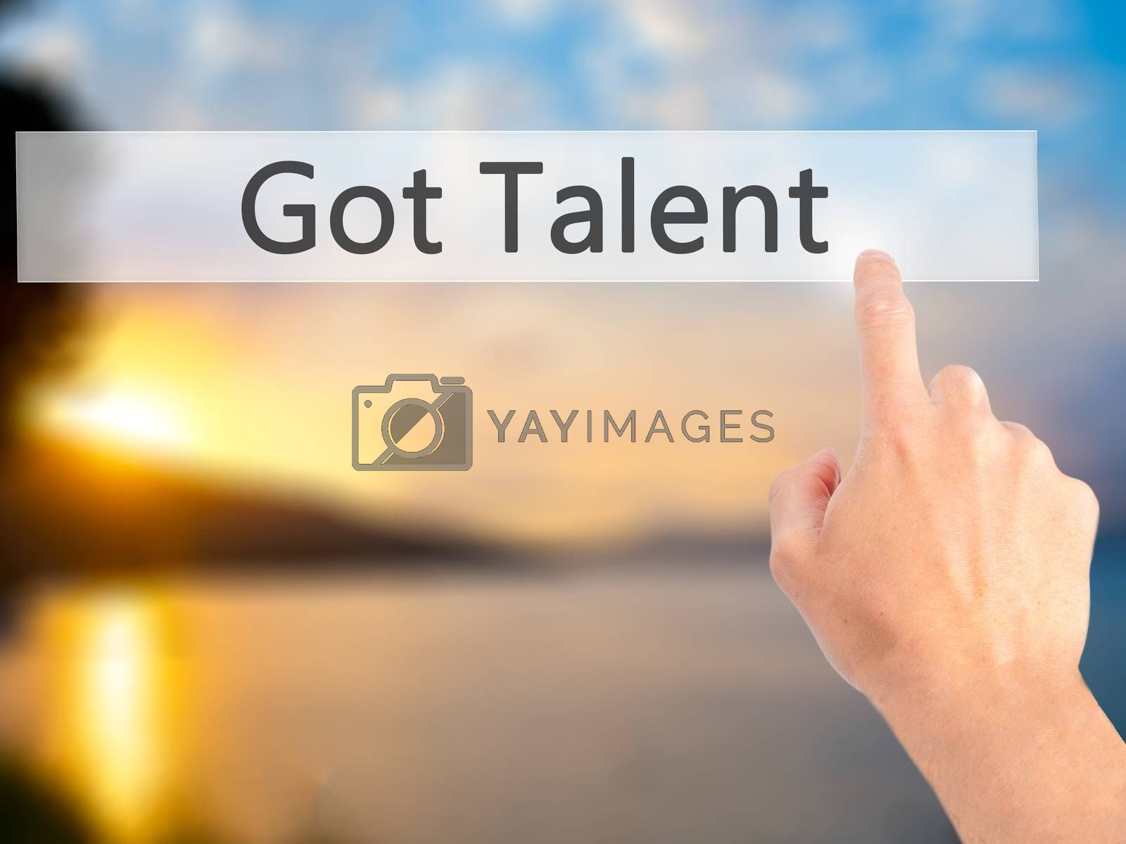 Got Talent - Hand pressing a button on blurred background concep by jackald