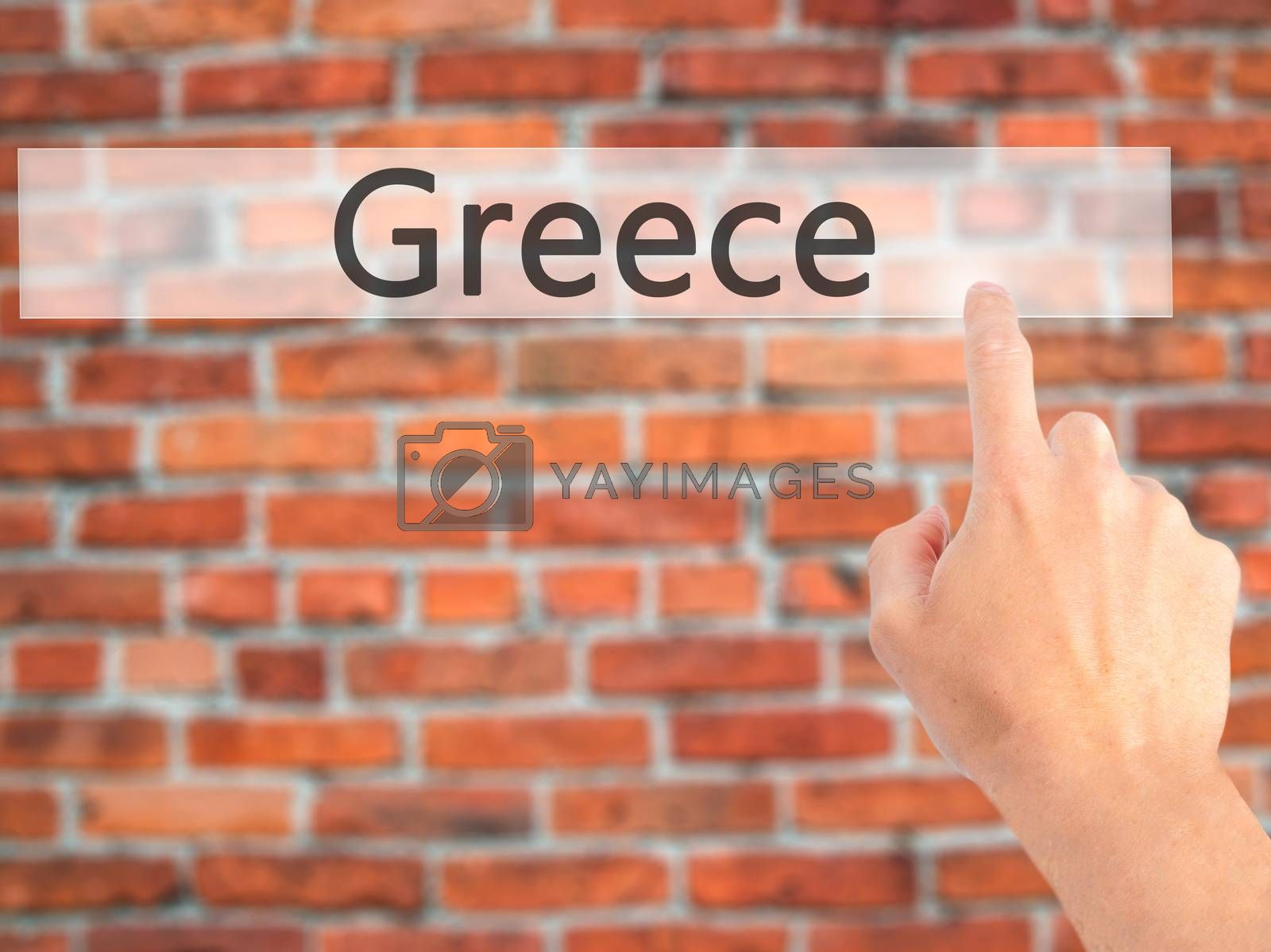 Greece - Hand pressing a button on blurred background concept on by jackald
