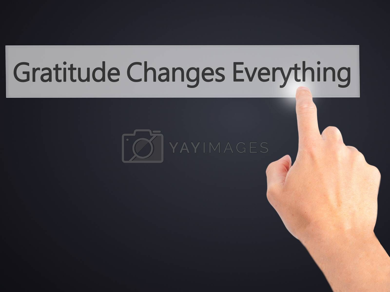 Gratitude Changes Everything - Hand pressing a button on blurred by jackald