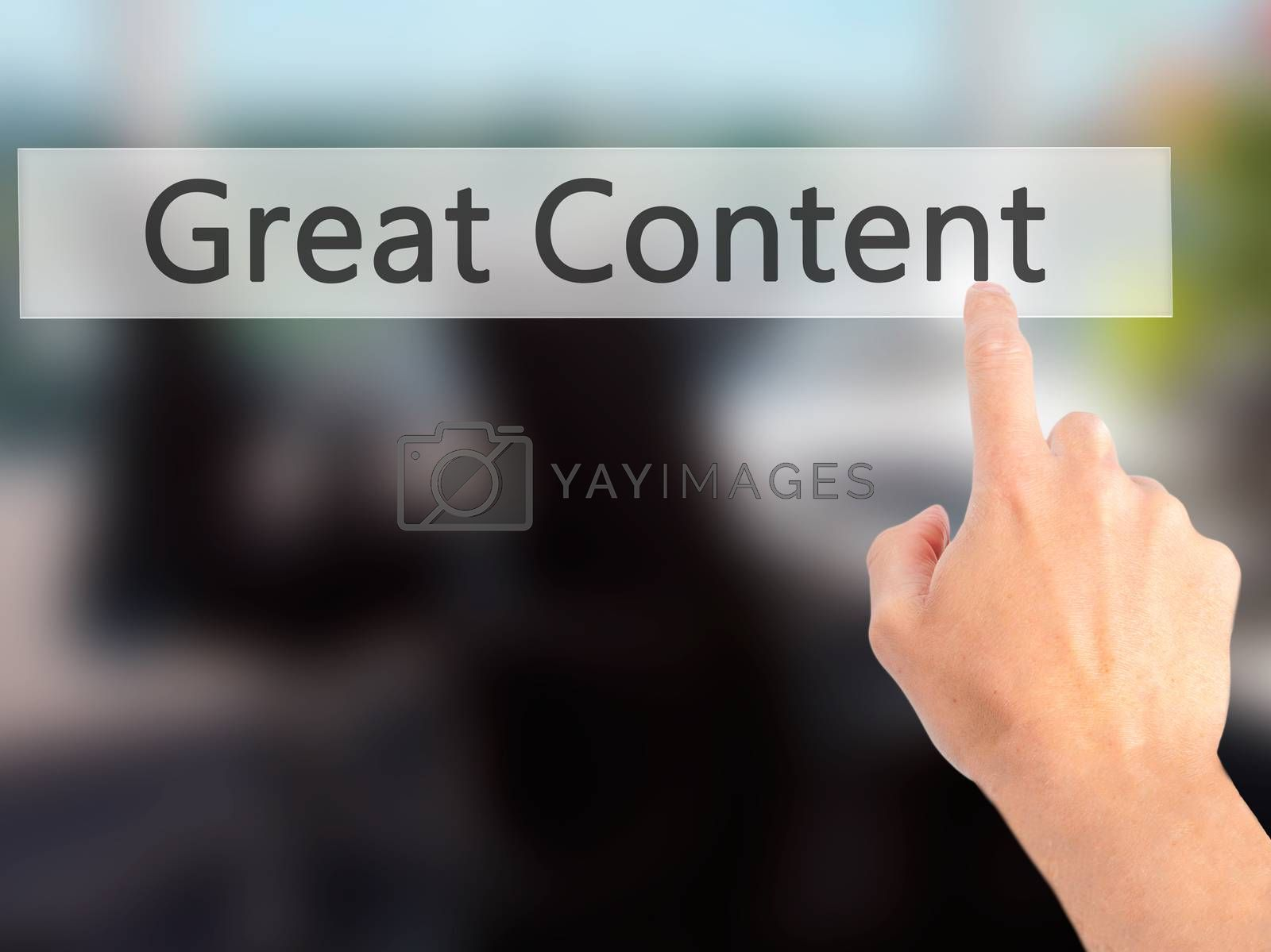 Great Content- Hand pressing a button on blurred background conc by netsay.net