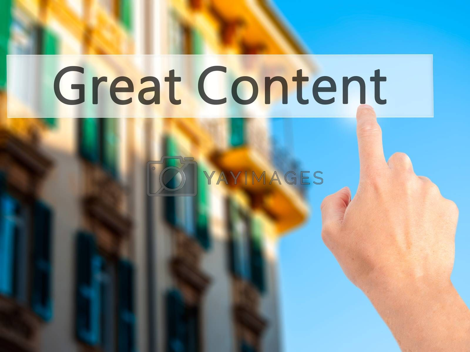 Great Content- Hand pressing a button on blurred background conc by jackald
