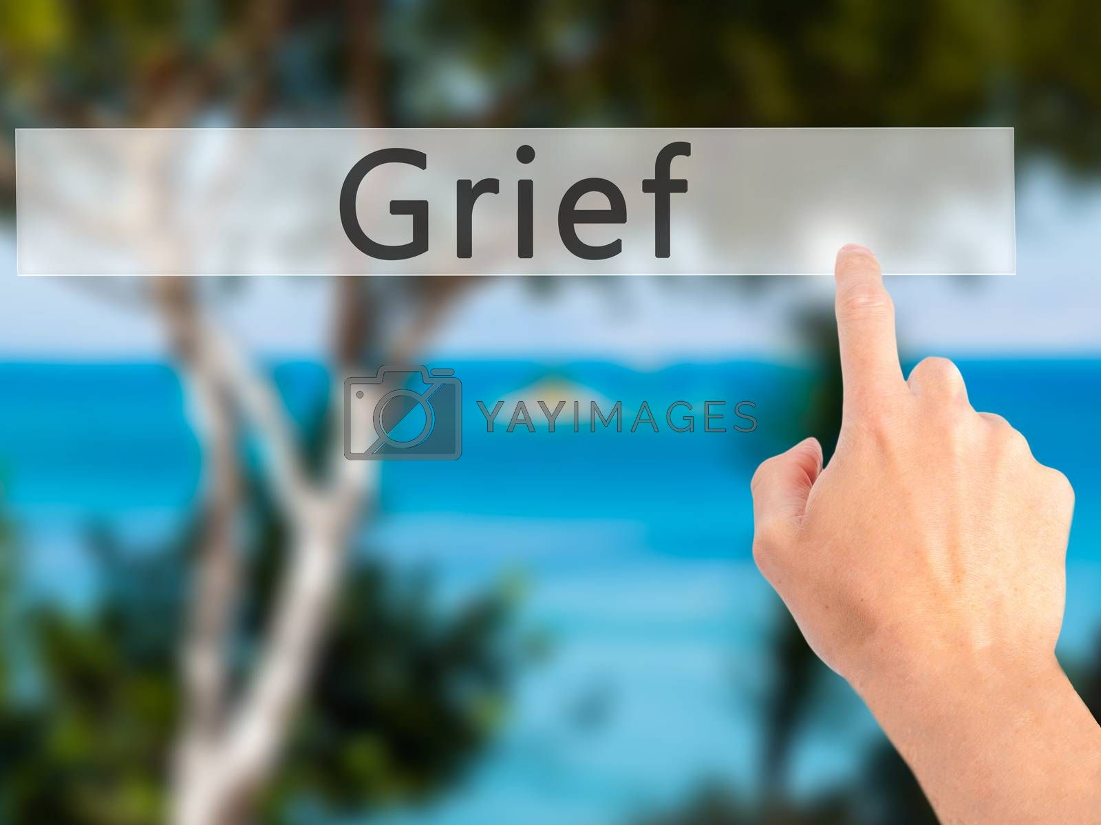 Grief - Hand pressing a button on blurred background concept on  by netsay.net