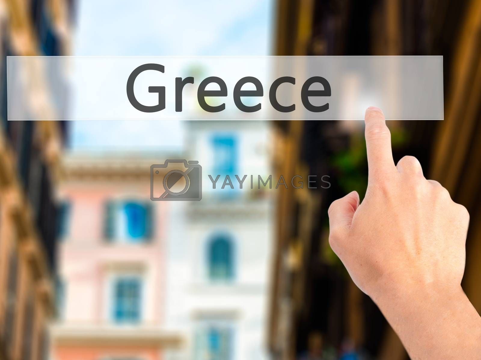 Greece - Hand pressing a button on blurred background concept on by netsay.net