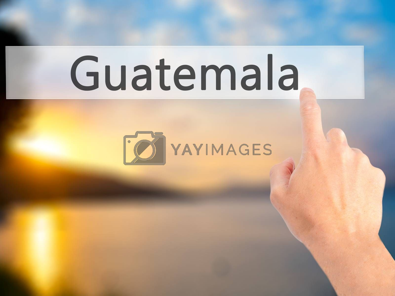 Guatemala - Hand pressing a button on blurred background concept by netsay.net