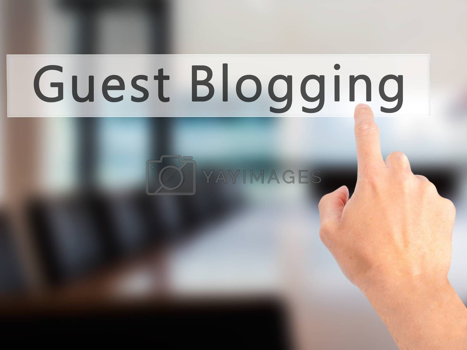 Guest Blogging - Hand pressing a button on blurred background co by netsay.net