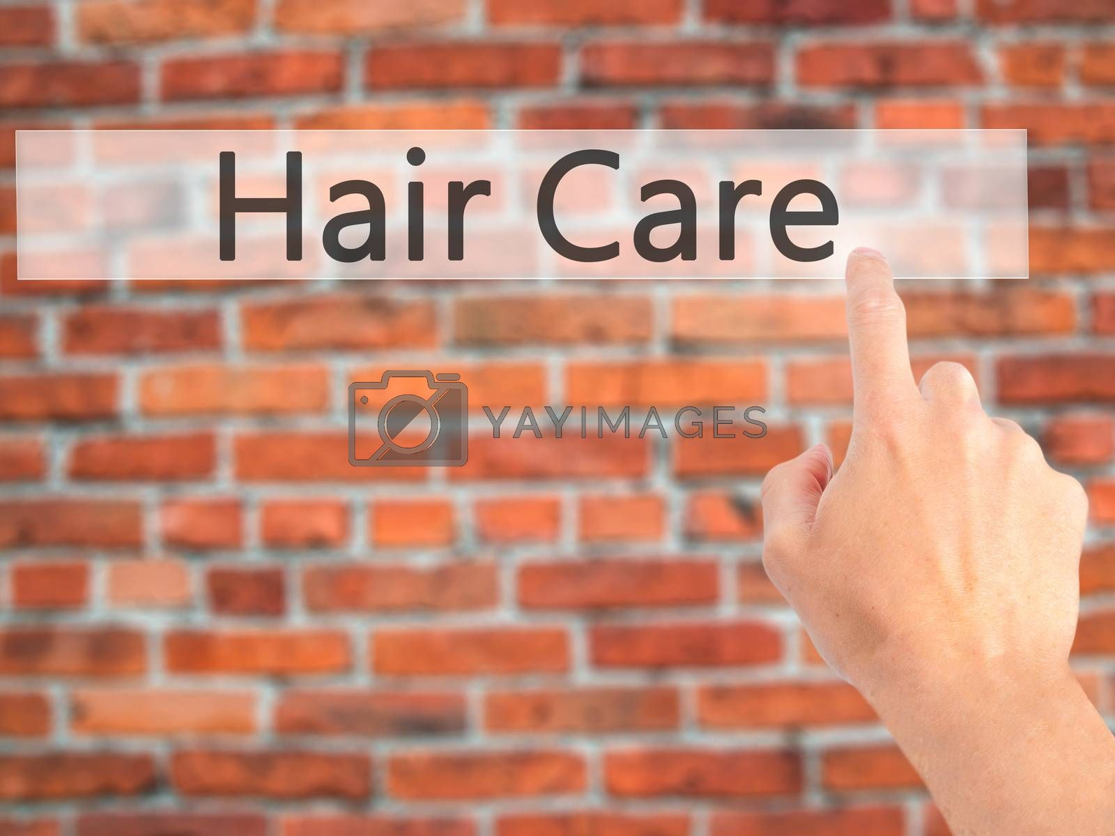 Hair Care - Hand pressing a button on blurred background concept by jackald