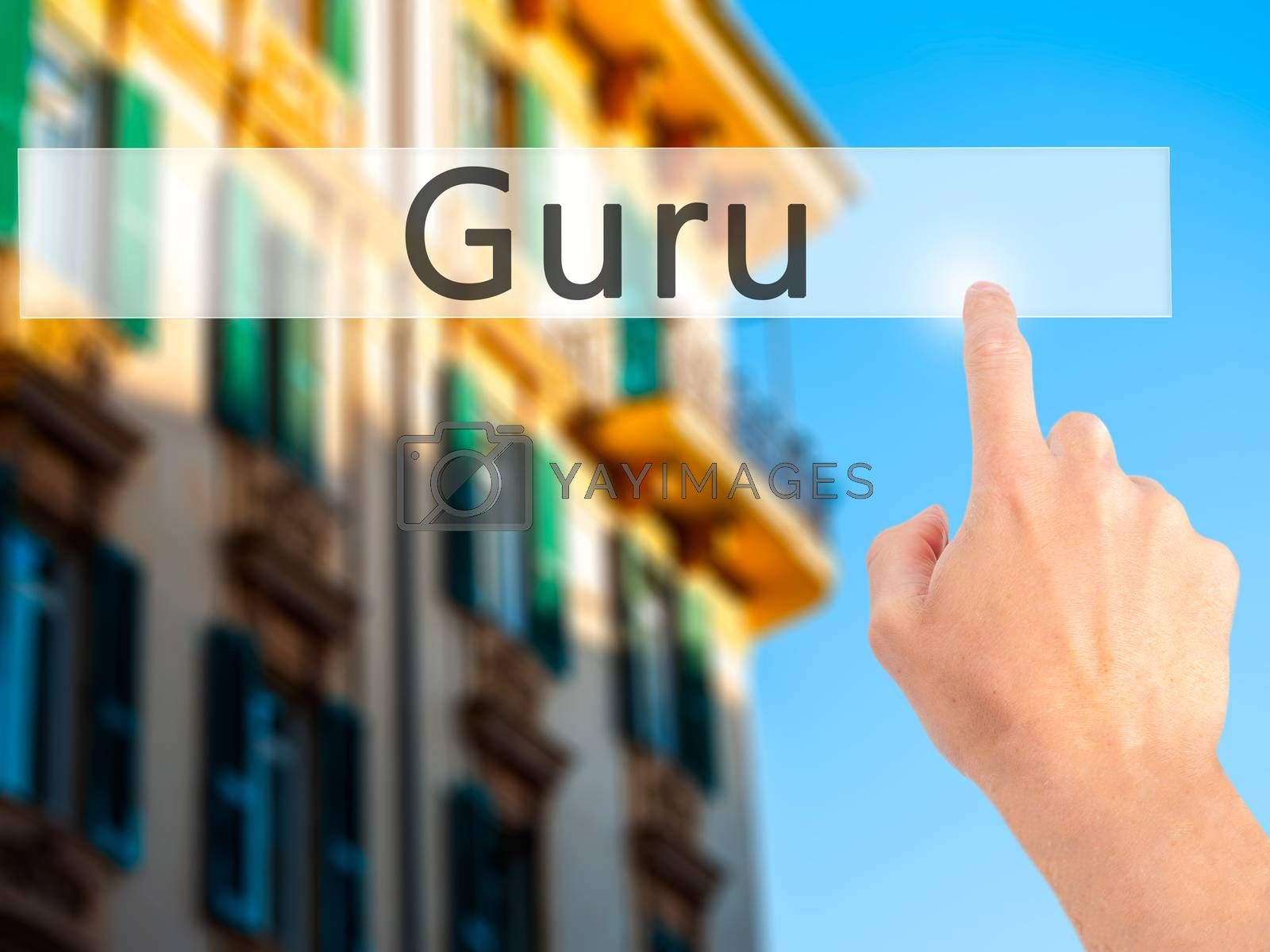 Guru - Hand pressing a button on blurred background concept on v by jackald