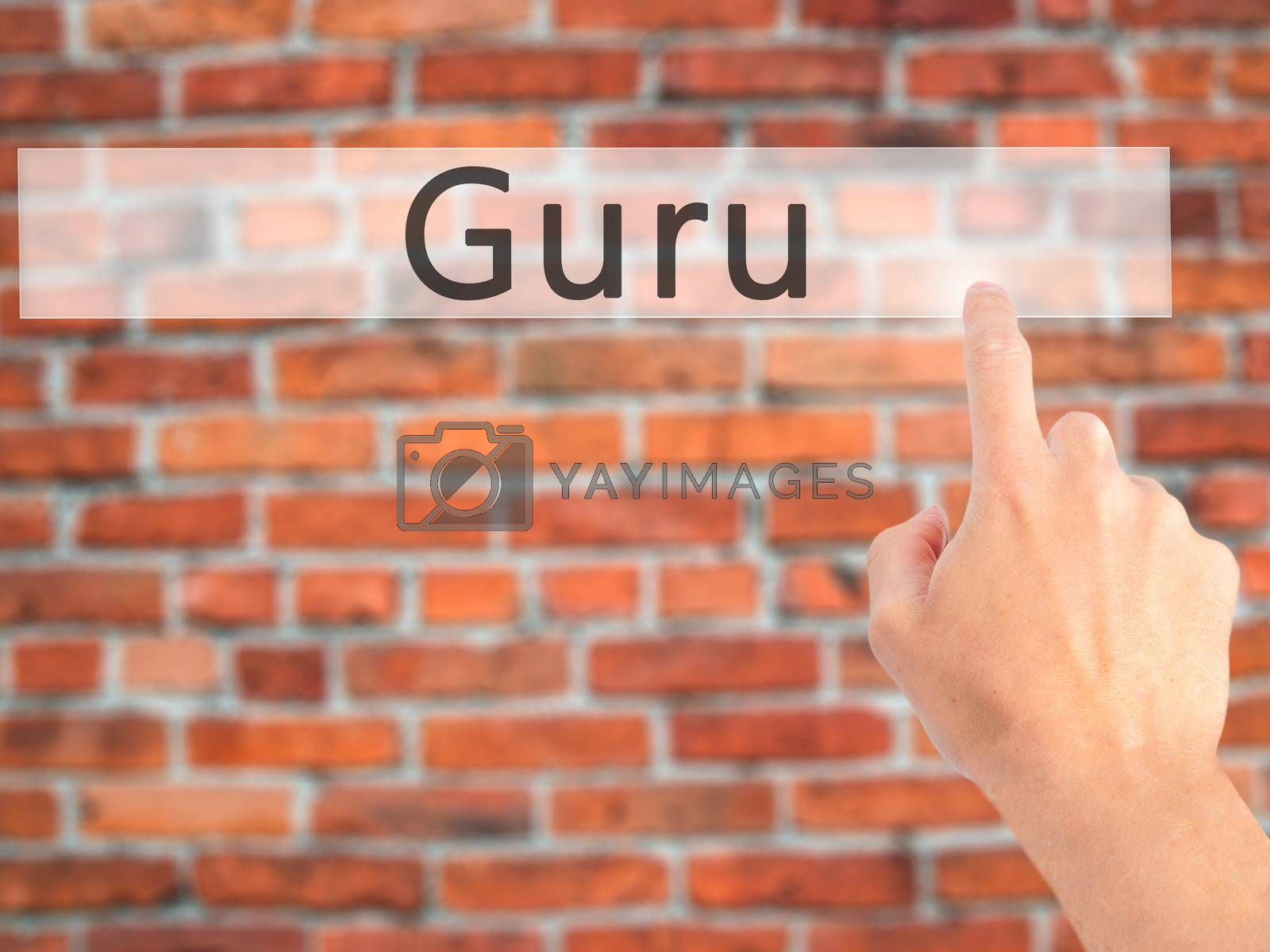 Guru - Hand pressing a button on blurred background concept on v by netsay.net
