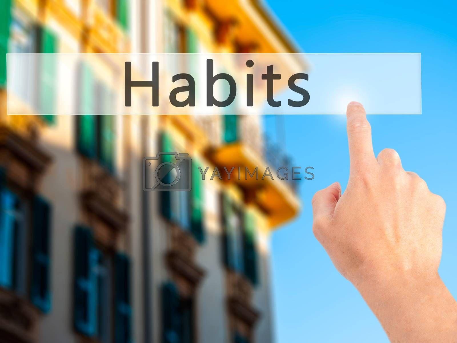 Habits - Hand pressing a button on blurred background concept on by jackald