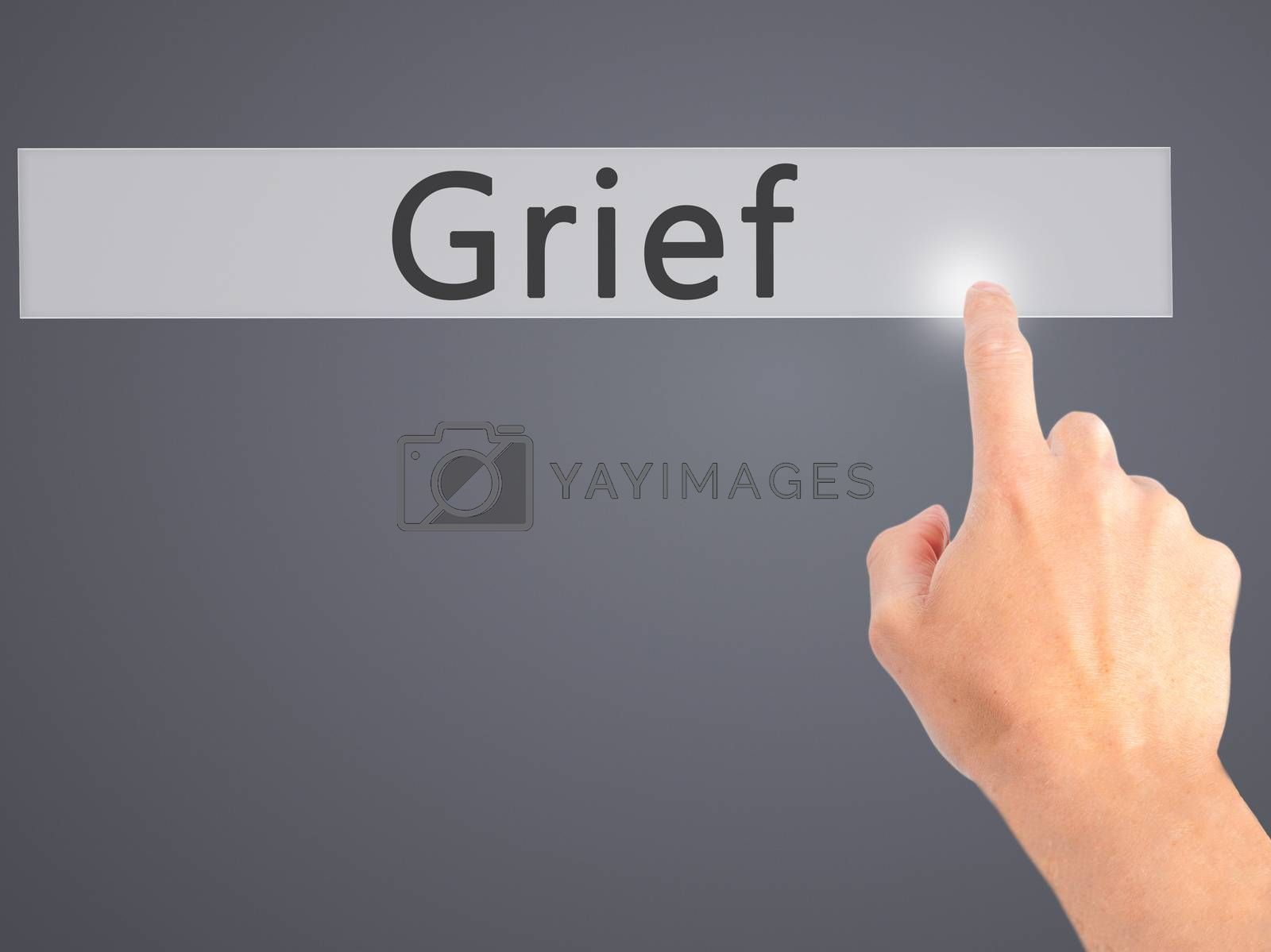 Grief - Hand pressing a button on blurred background concept on  by jackald