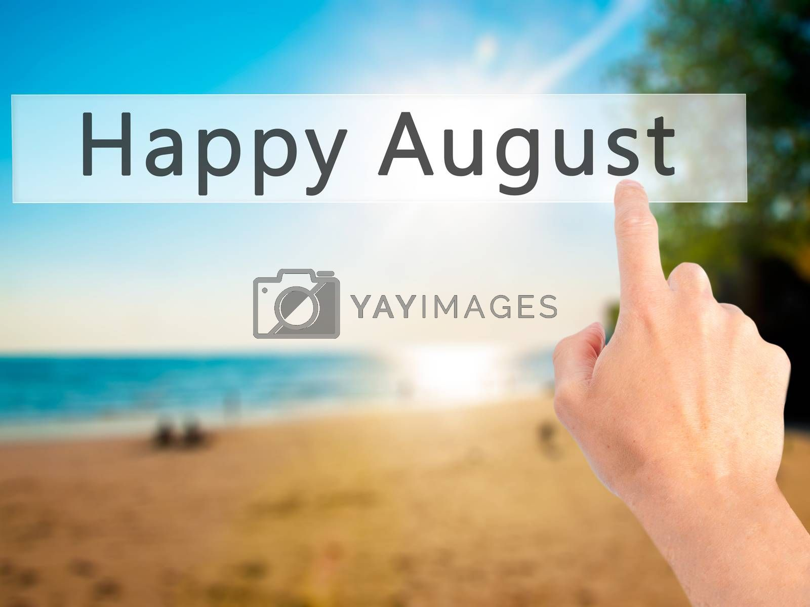 Happy August - Hand pressing a button on blurred background conc by netsay.net