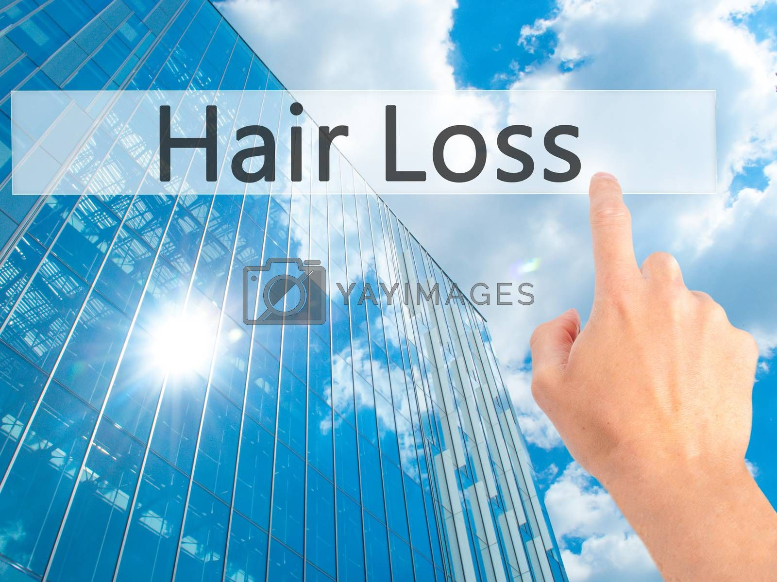 Hair Loss - Hand pressing a button on blurred background concept by jackald