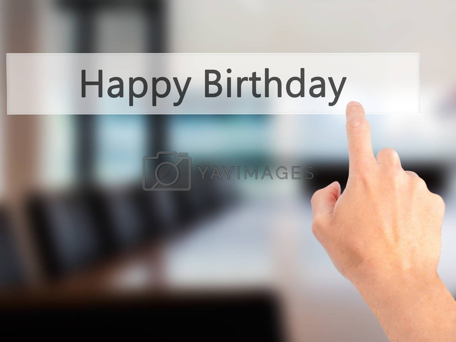 Happy Birthday - Hand pressing a button on blurred background co by netsay.net