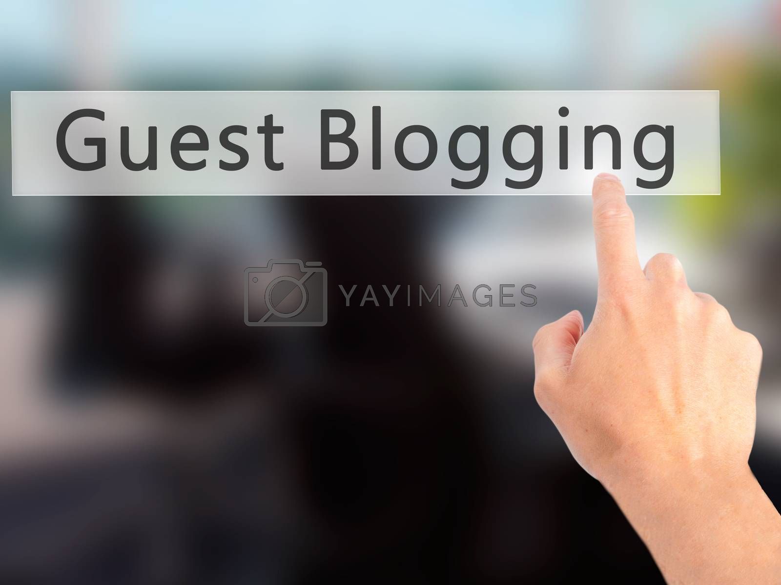 Guest Blogging - Hand pressing a button on blurred background co by jackald