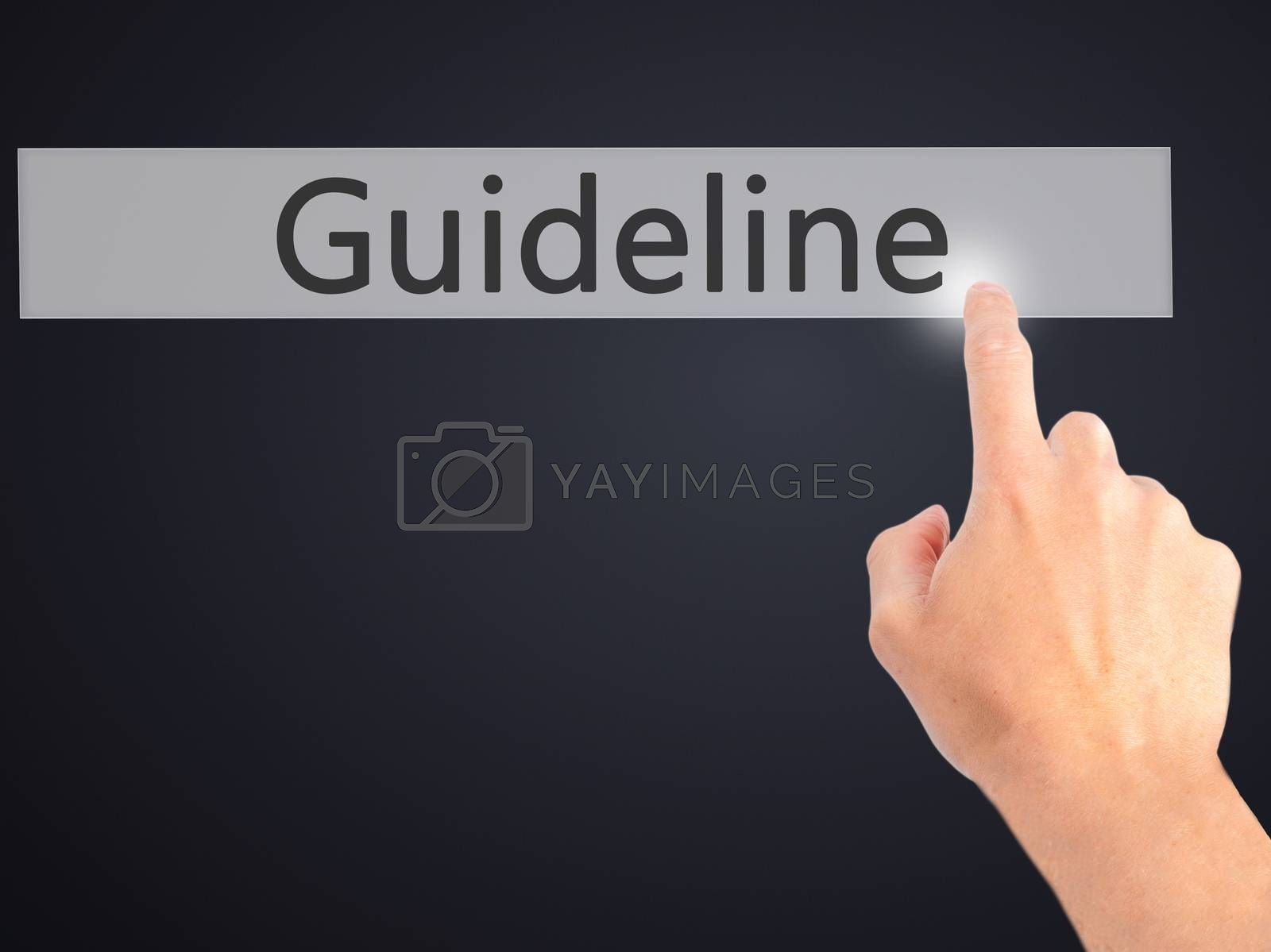 Guideline  - Hand pressing a button on blurred background concep by jackald