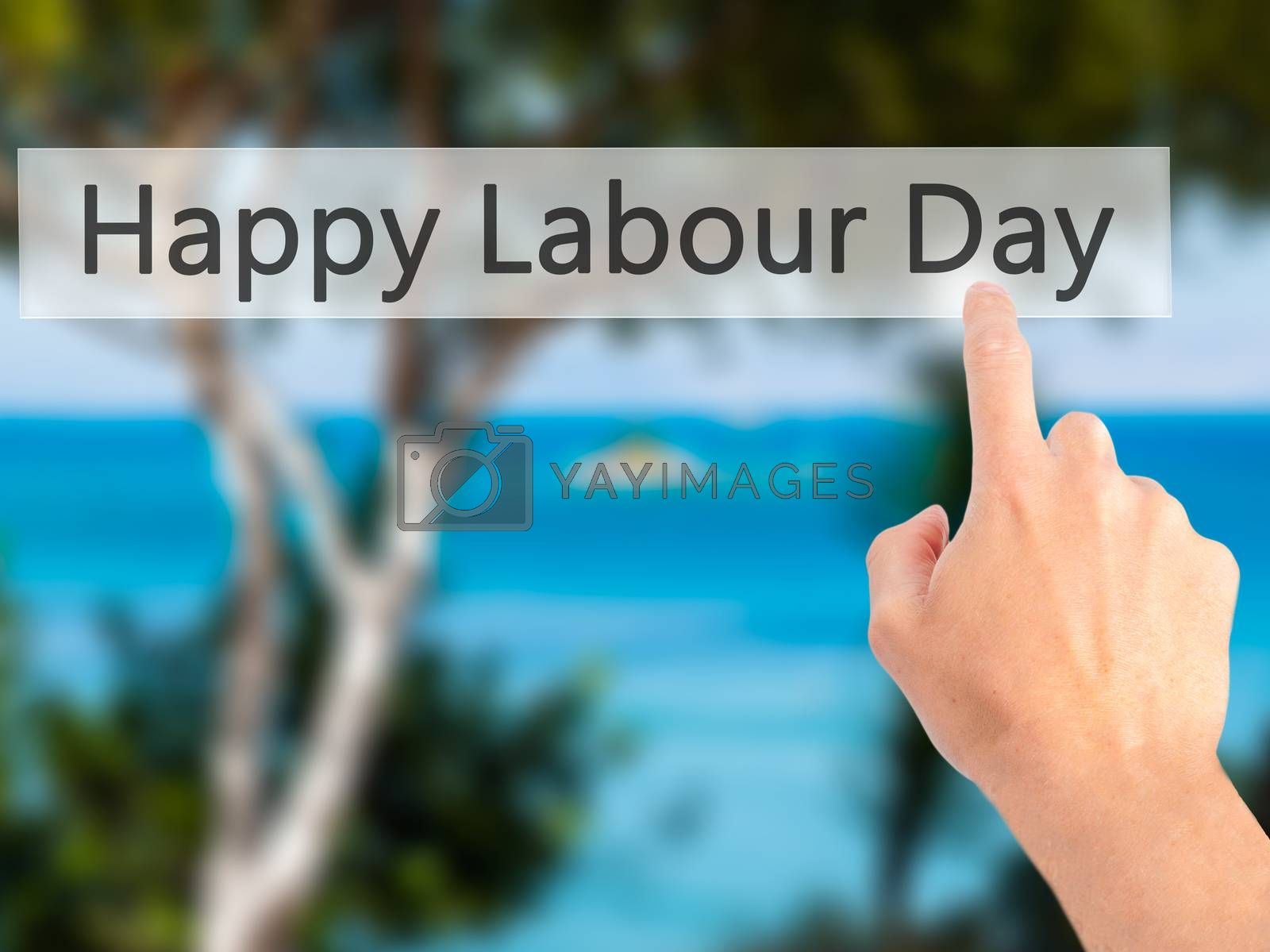 Happy Labour Day - Hand pressing a button on blurred background  by netsay.net