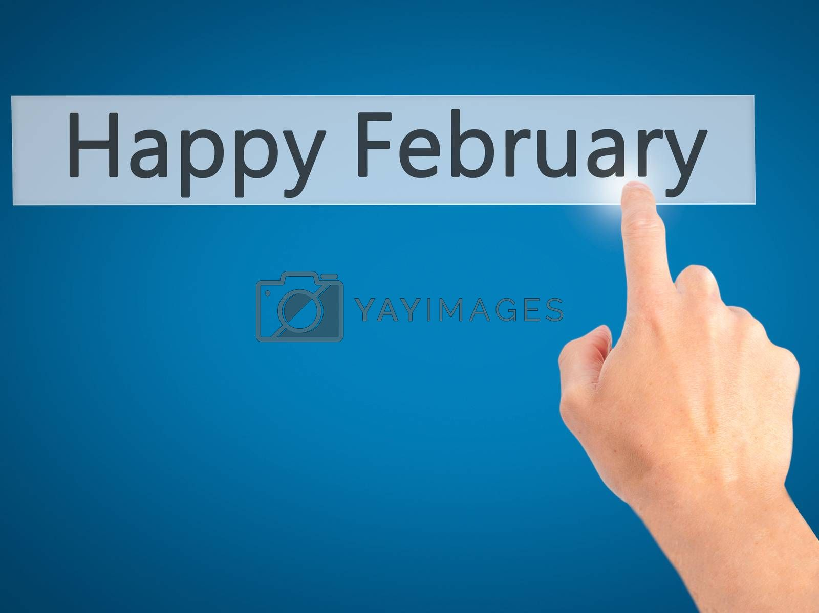 Happy February - Hand pressing a button on blurred background co by jackald