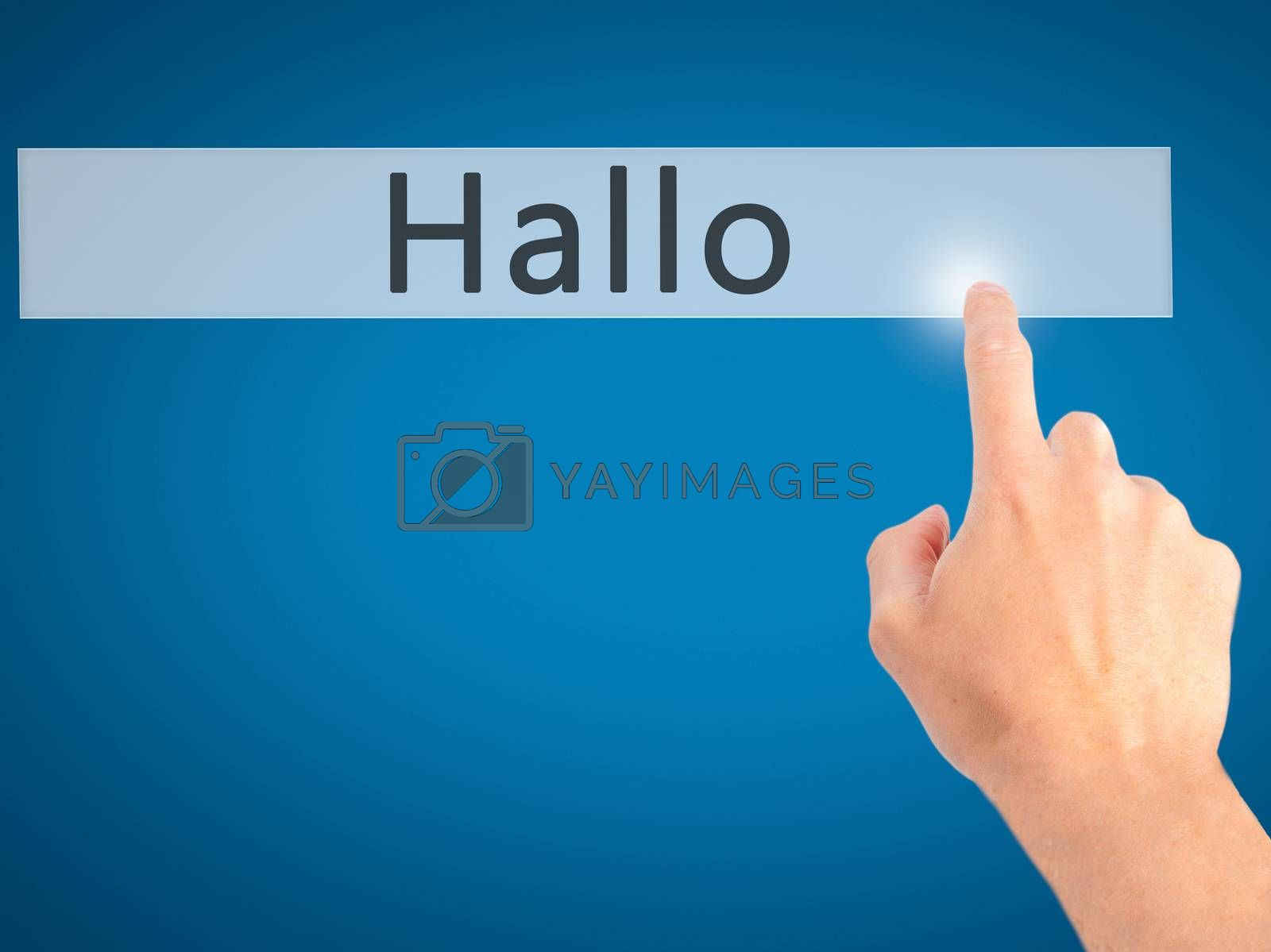 Hallo (Hello in German) - Hand pressing a button on blurred back by jackald