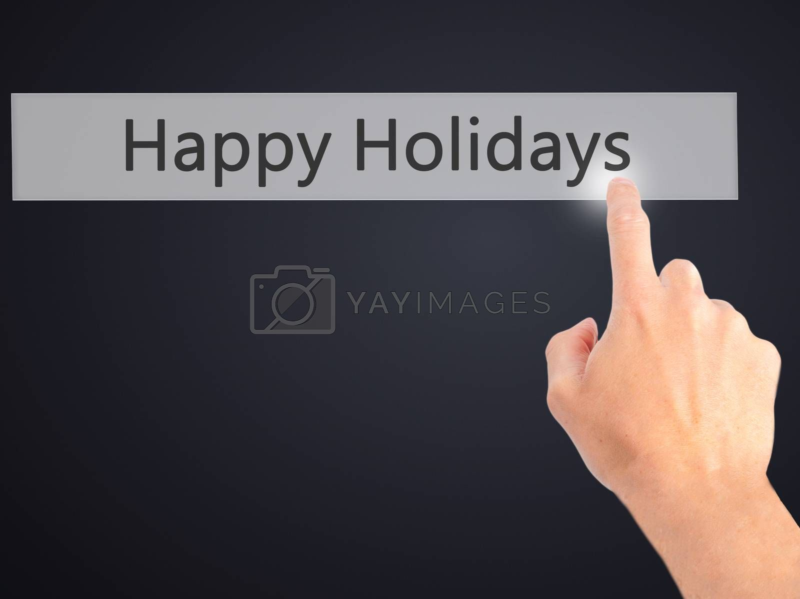 Happy Holidays - Hand pressing a button on blurred background co by netsay.net