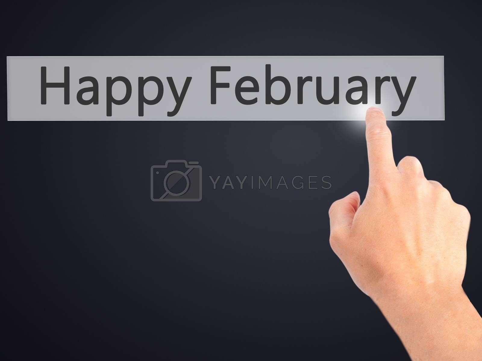 Happy February - Hand pressing a button on blurred background co by netsay.net