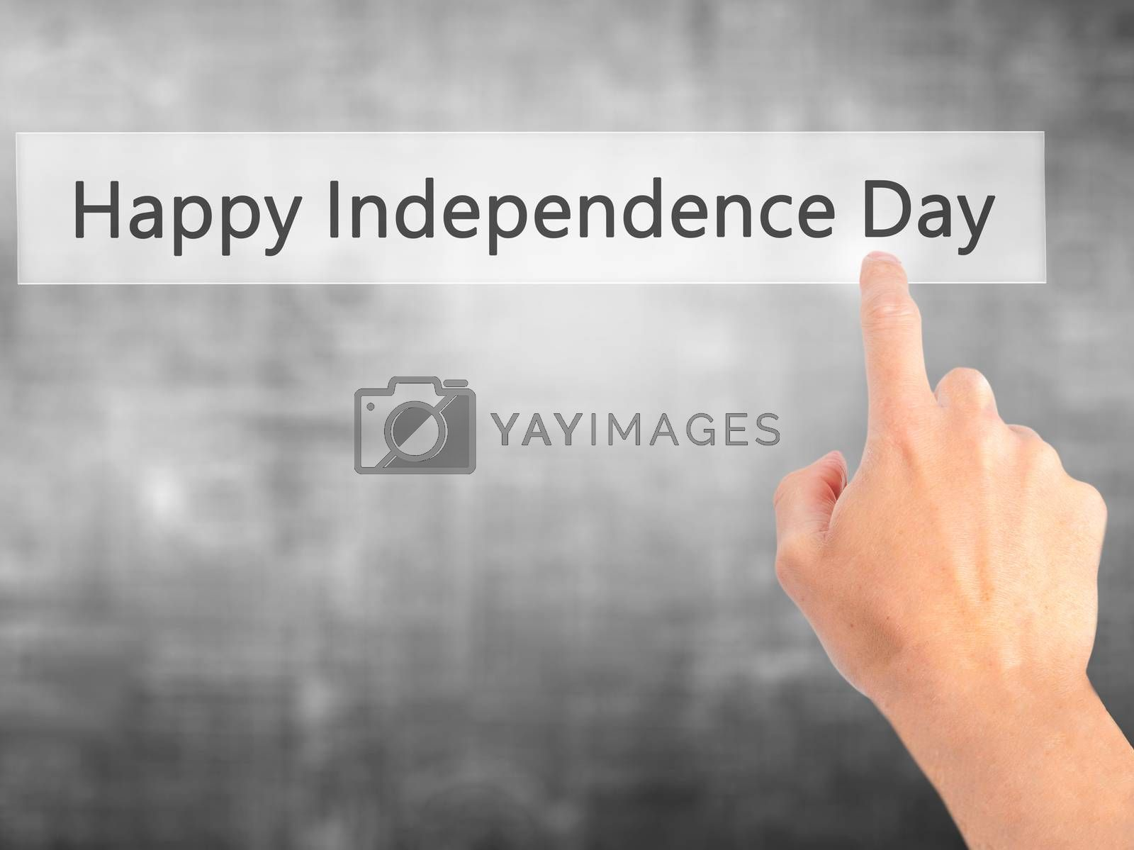 happy Independence Day - Hand pressing a button on blurred backg by jackald