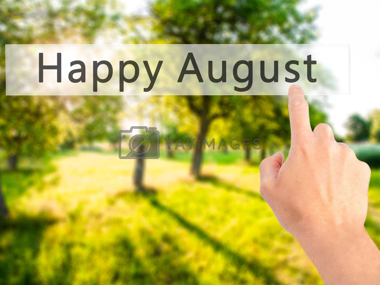 Happy August - Hand pressing a button on blurred background conc by jackald