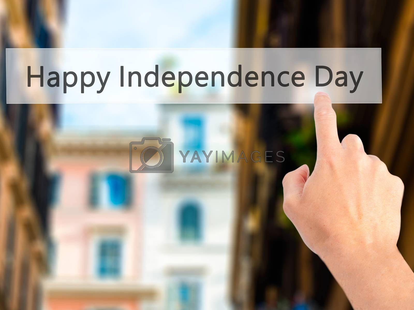 happy Independence Day - Hand pressing a button on blurred backg by netsay.net