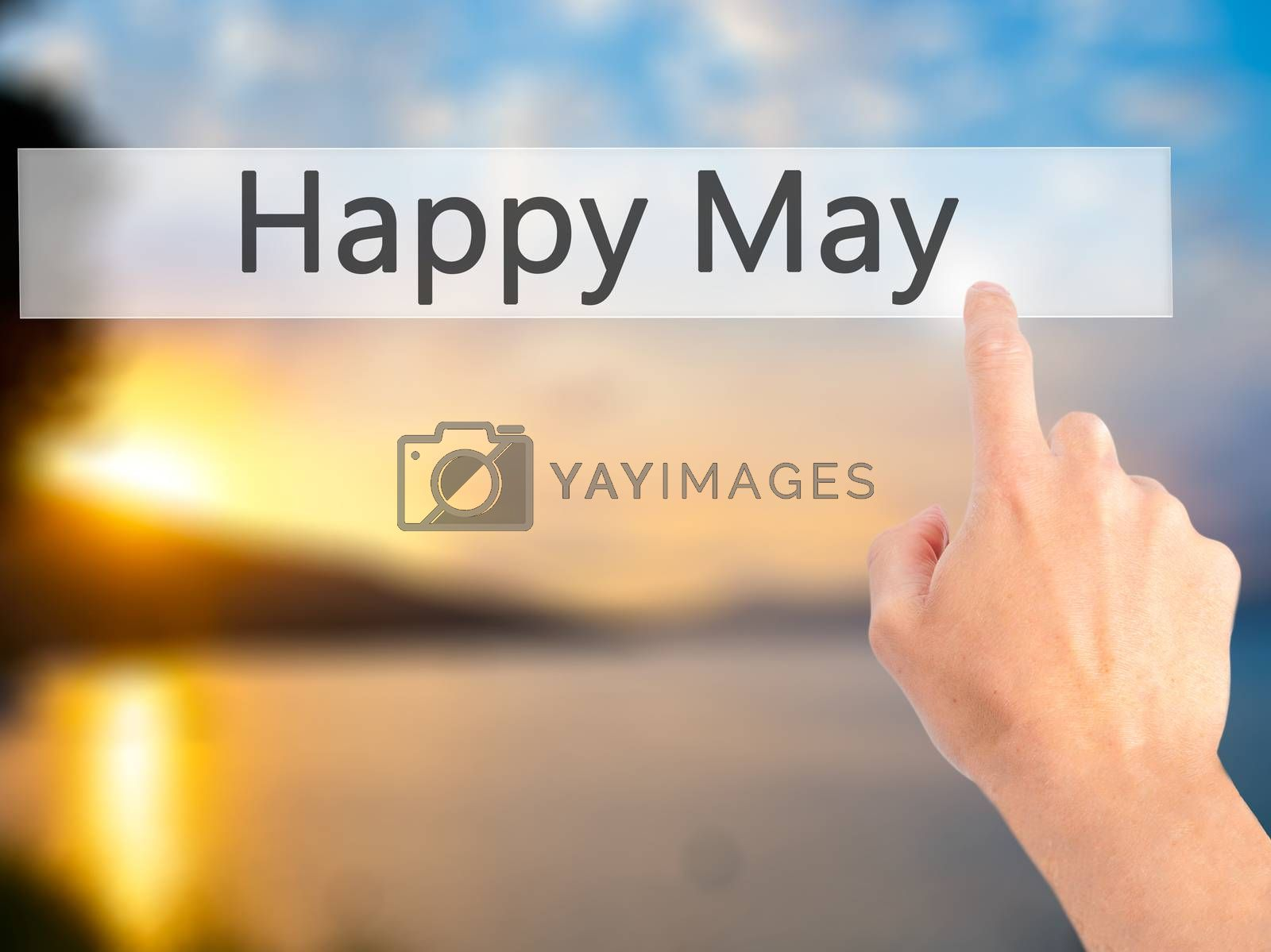 Happy May - Hand pressing a button on blurred background concept by jackald