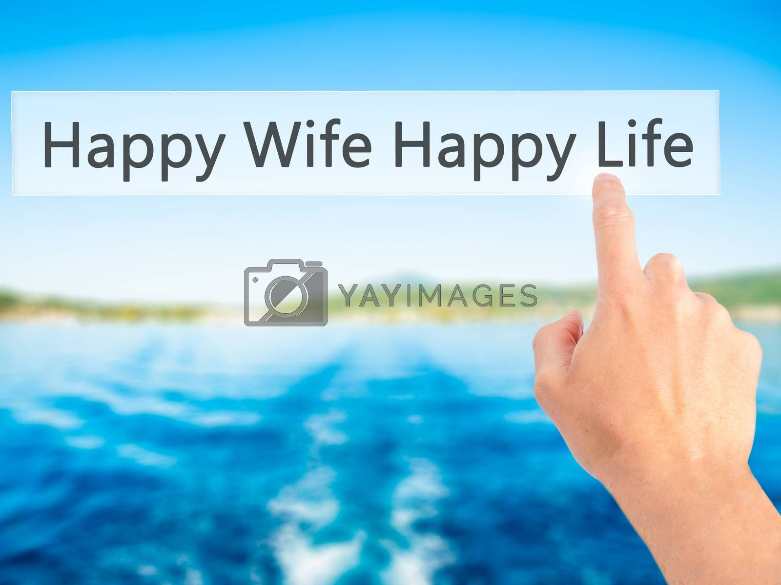 Happy Wife Happy Life - Hand pressing a button on blurred backgr by jackald