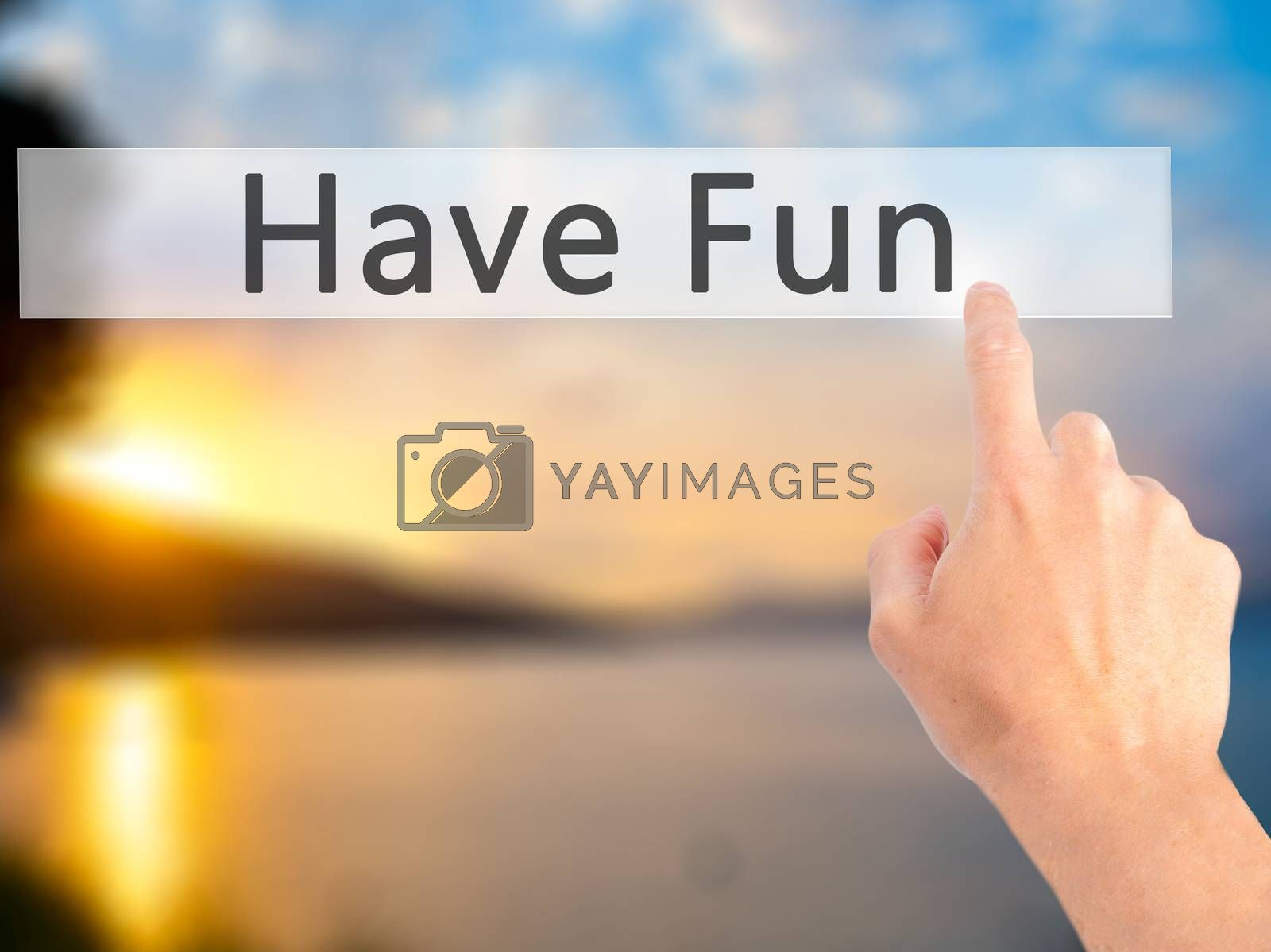 Have Fun - Hand pressing a button on blurred background concept  by jackald