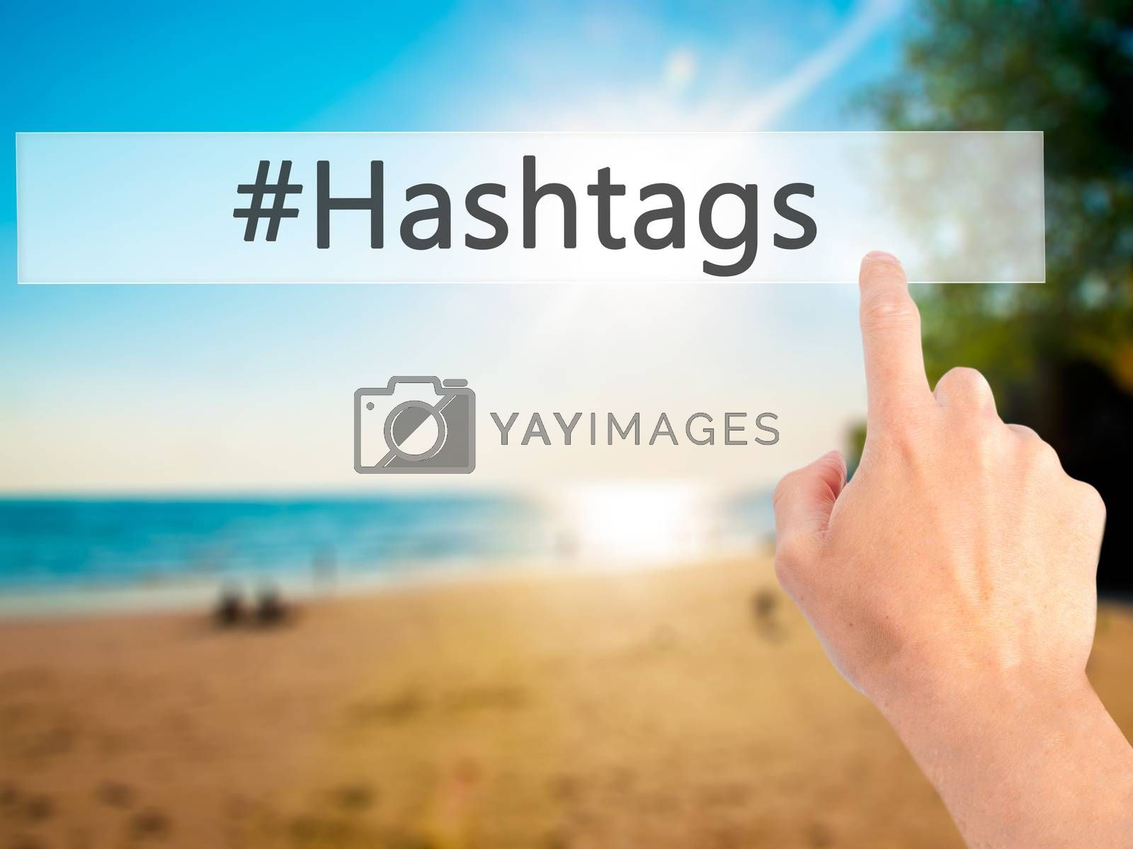 #Hashtags - Hand pressing a button on blurred background concept by jackald