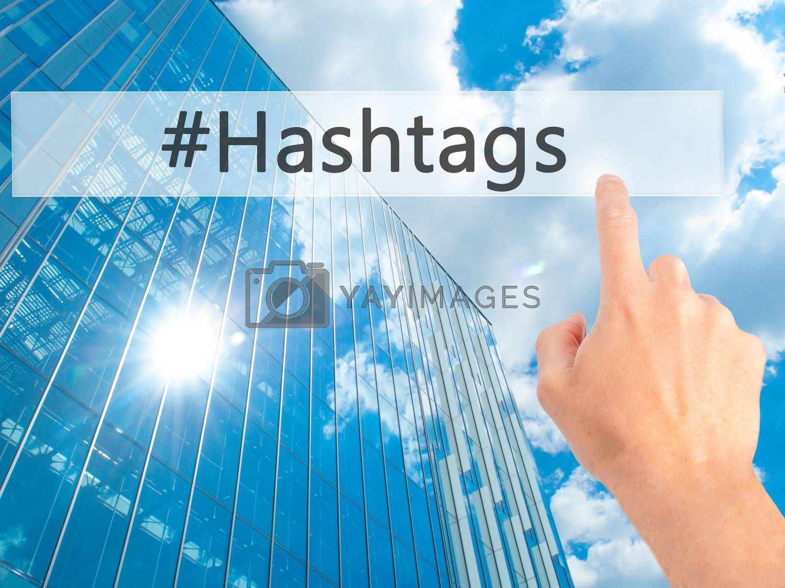 #Hashtags - Hand pressing a button on blurred background concept by netsay.net