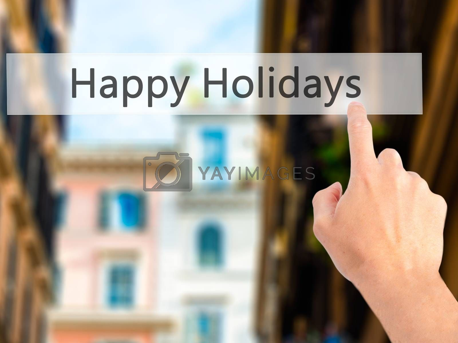 Happy Holidays - Hand pressing a button on blurred background co by jackald