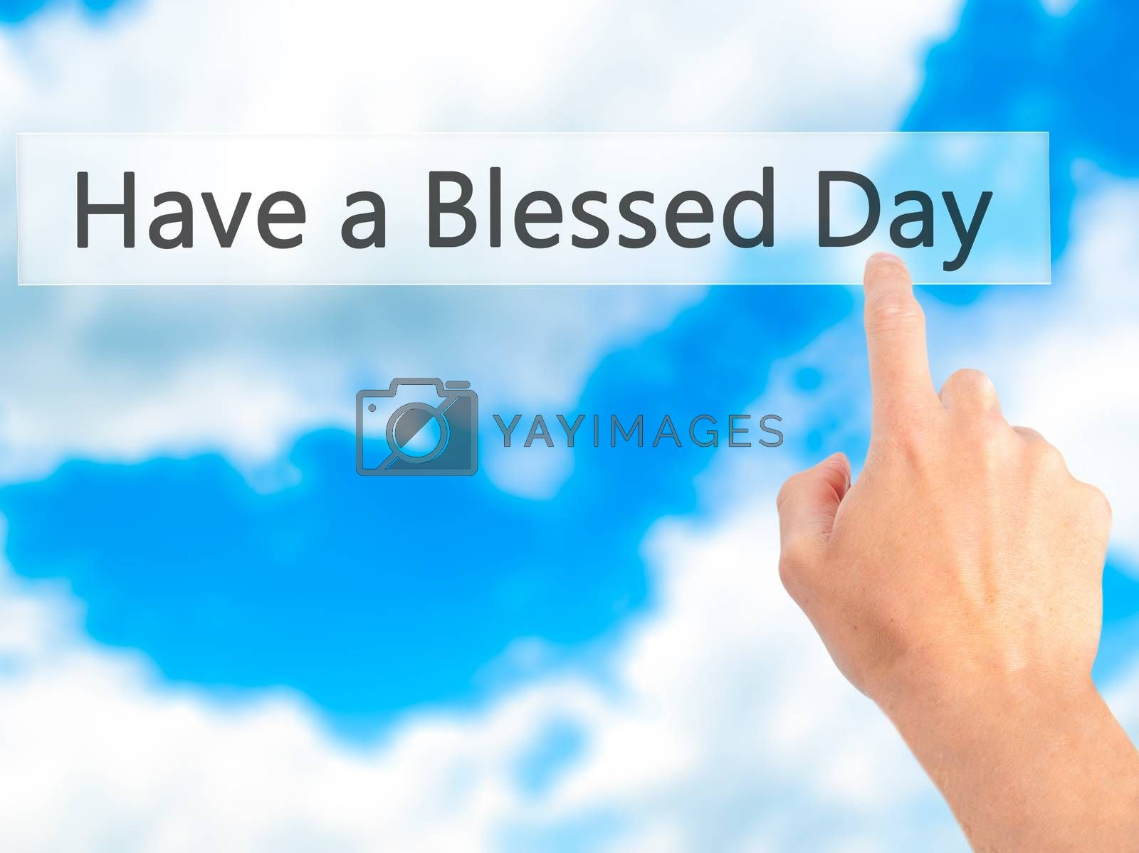Have a Blessed Day - Hand pressing a button on blurred backgroun by netsay.net