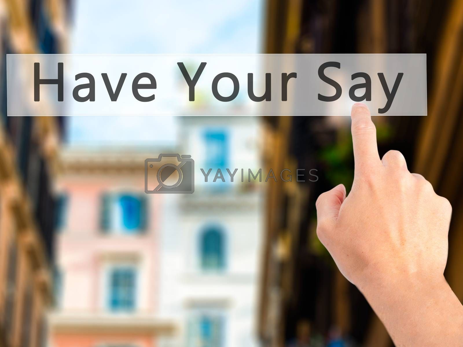 Have Your Say - Hand pressing a button on blurred background con by jackald
