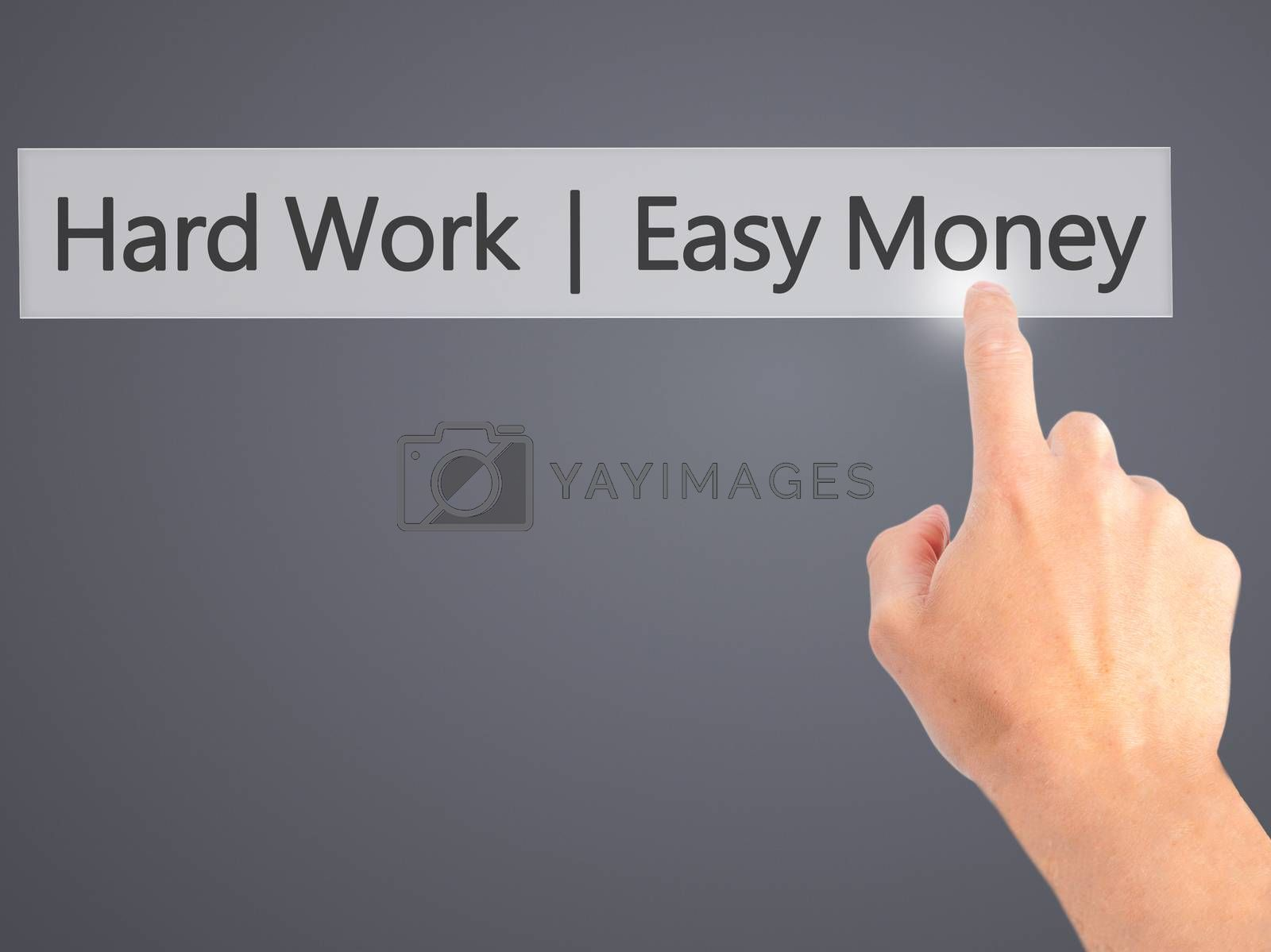 Hard Work  Easy Money - Hand pressing a button on blurred backgr by netsay.net