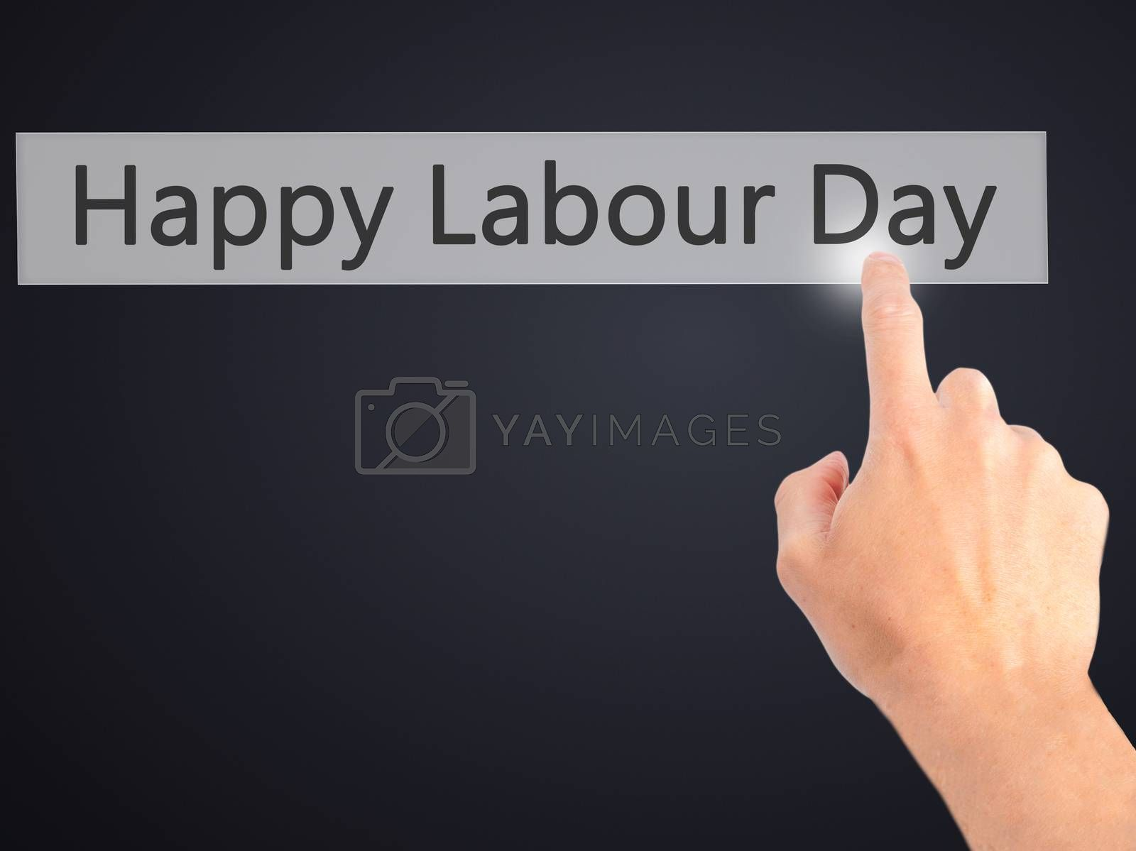 Happy Labour Day - Hand pressing a button on blurred background  by jackald