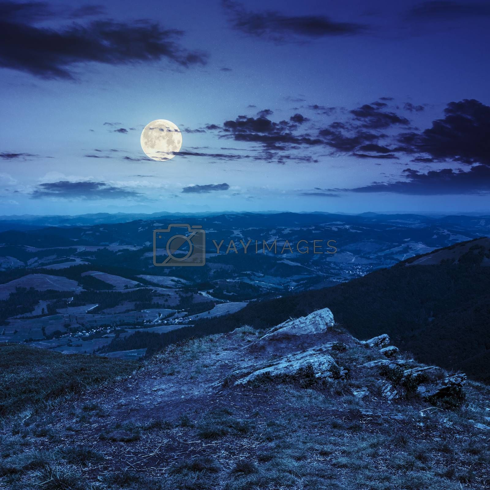 stones on the hillside at night by Pellinni