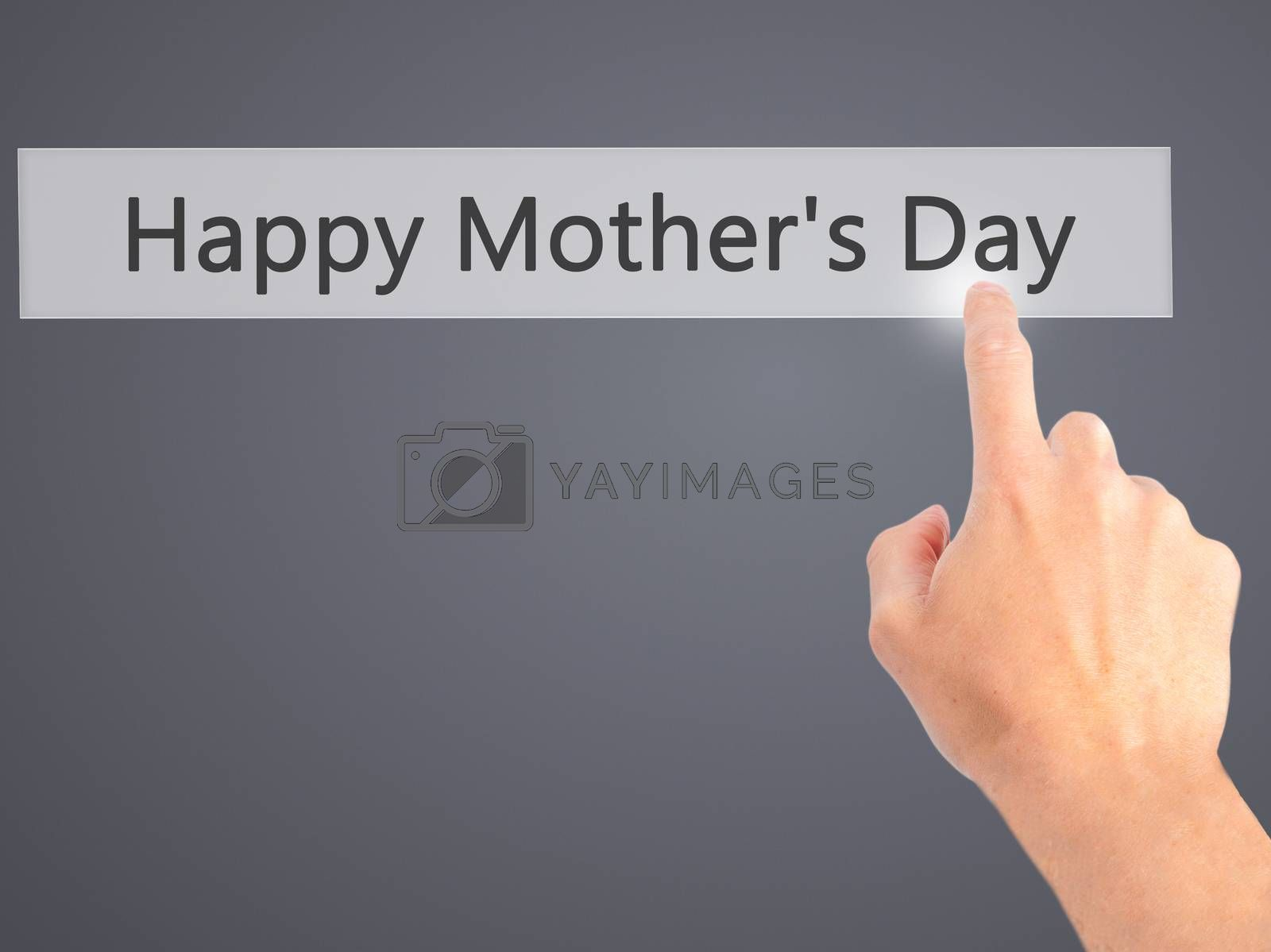 Happy Mother's Day - Hand pressing a button on blurred backgroun by jackald