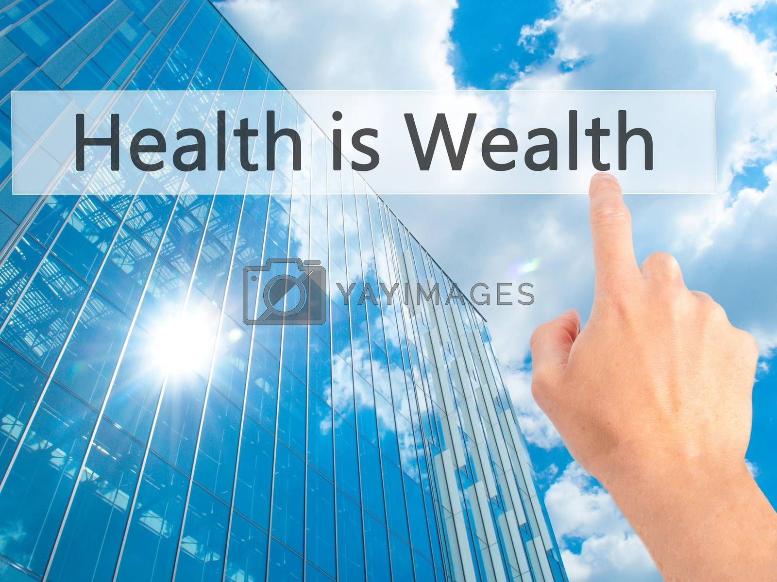 Health is Wealth - Hand pressing a button on blurred background  by jackald