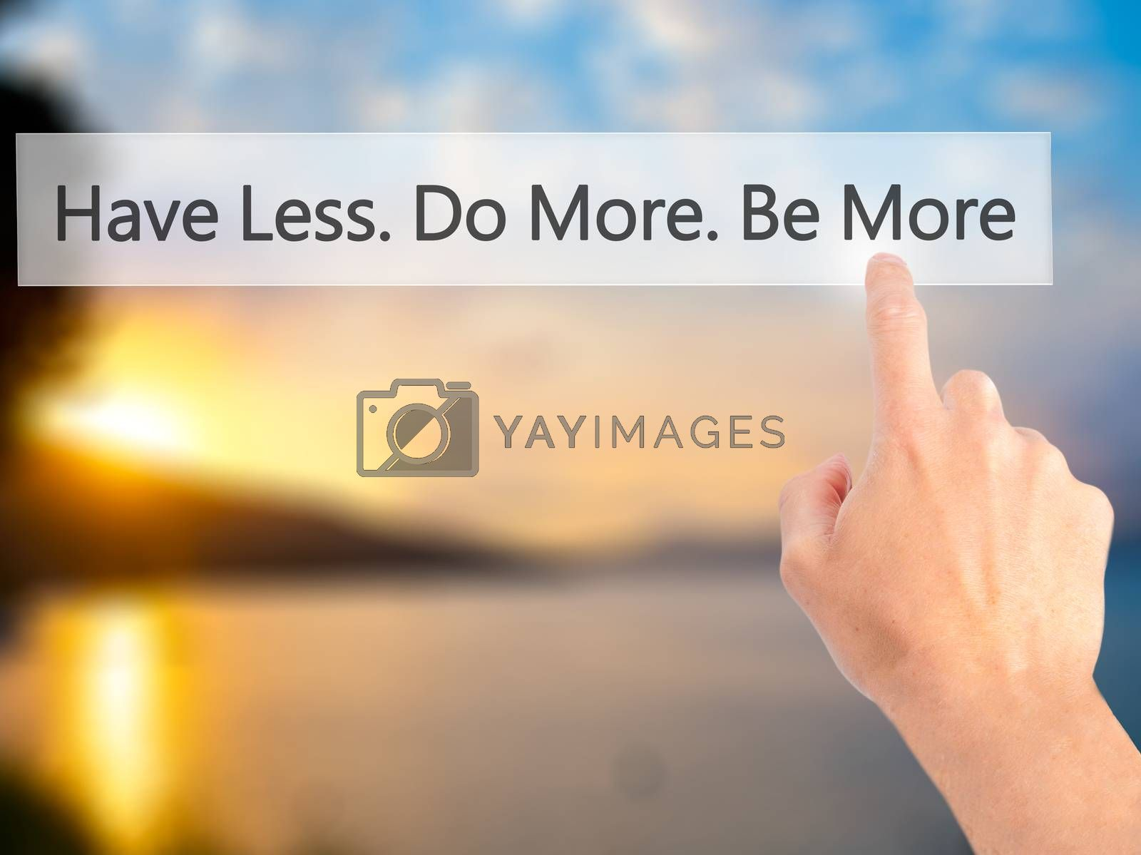 Have Less. Do More. Be More  - Hand pressing a button on blurred by jackald