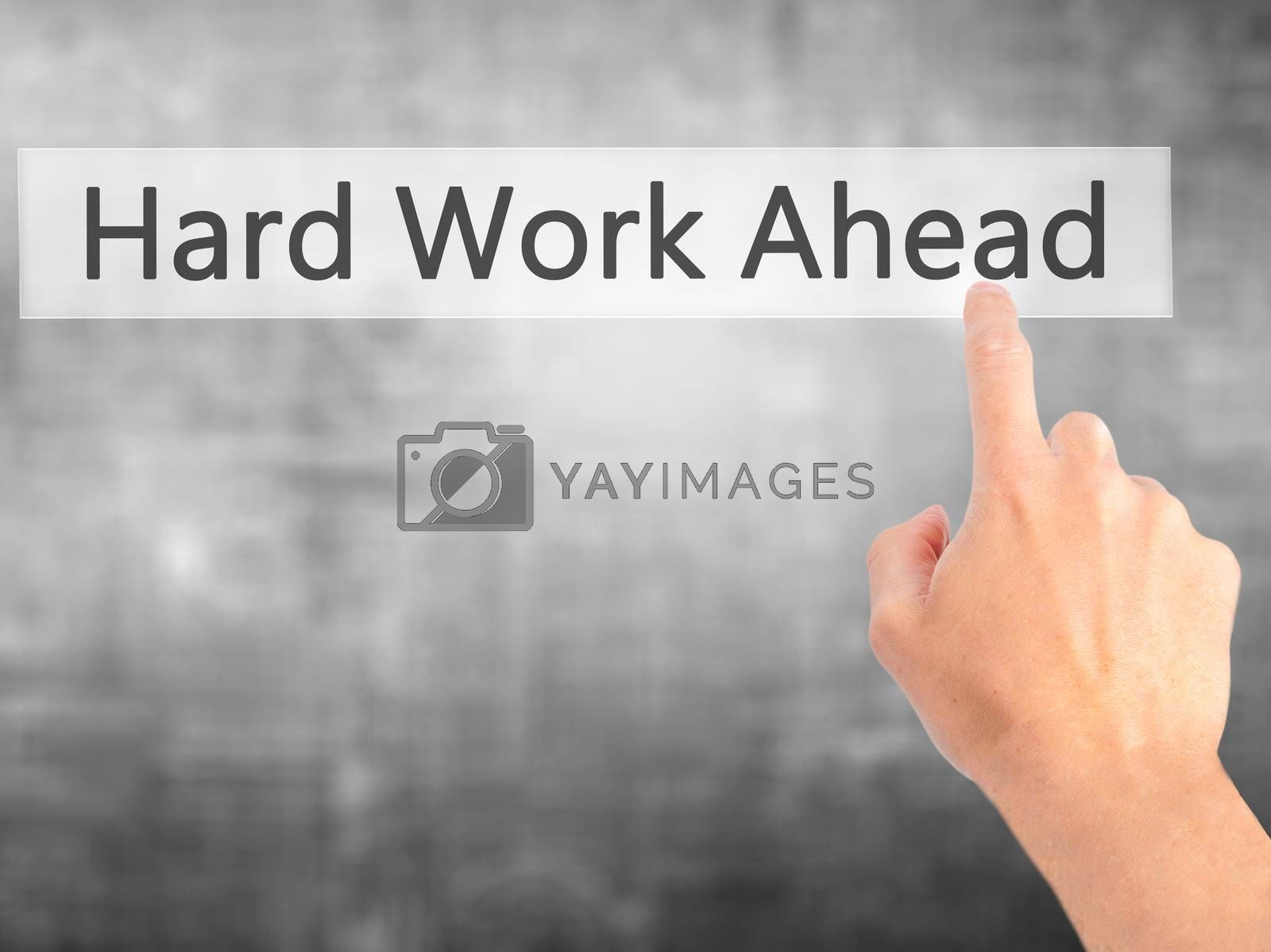Hard Work Ahead - Hand pressing a button on blurred background c by netsay.net