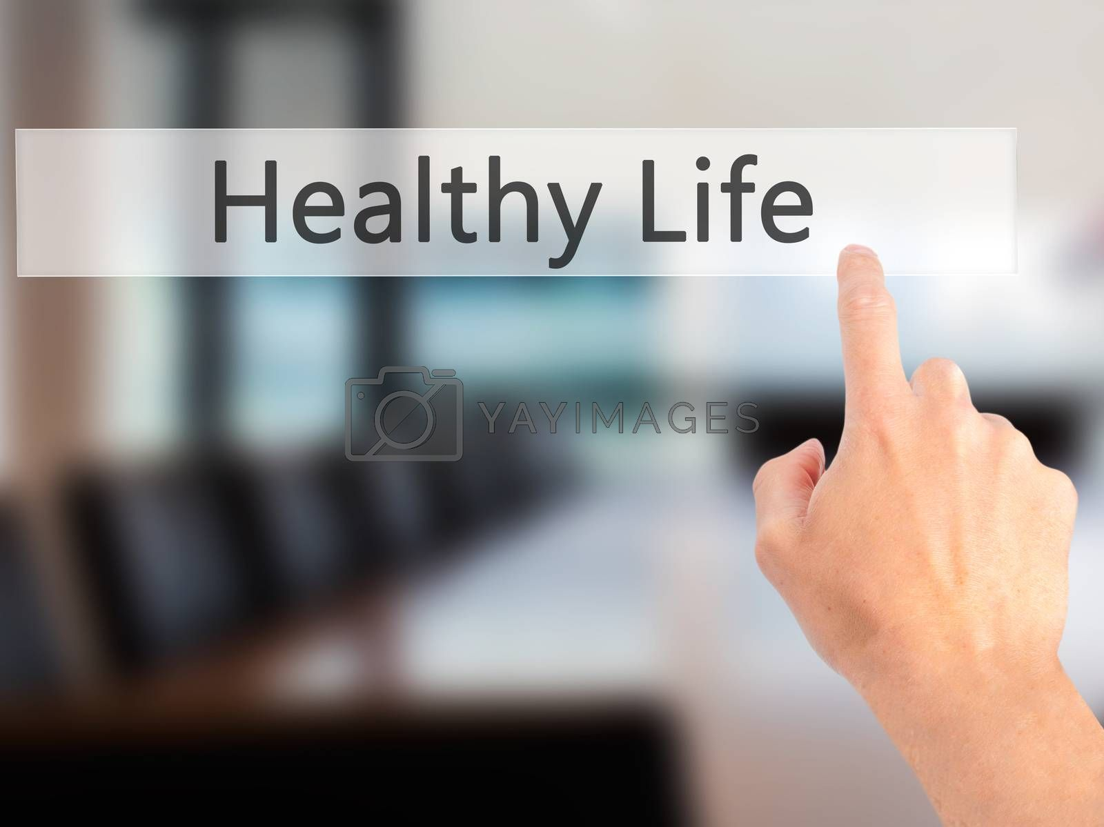 Healthy Life - Hand pressing a button on blurred background conc by netsay.net
