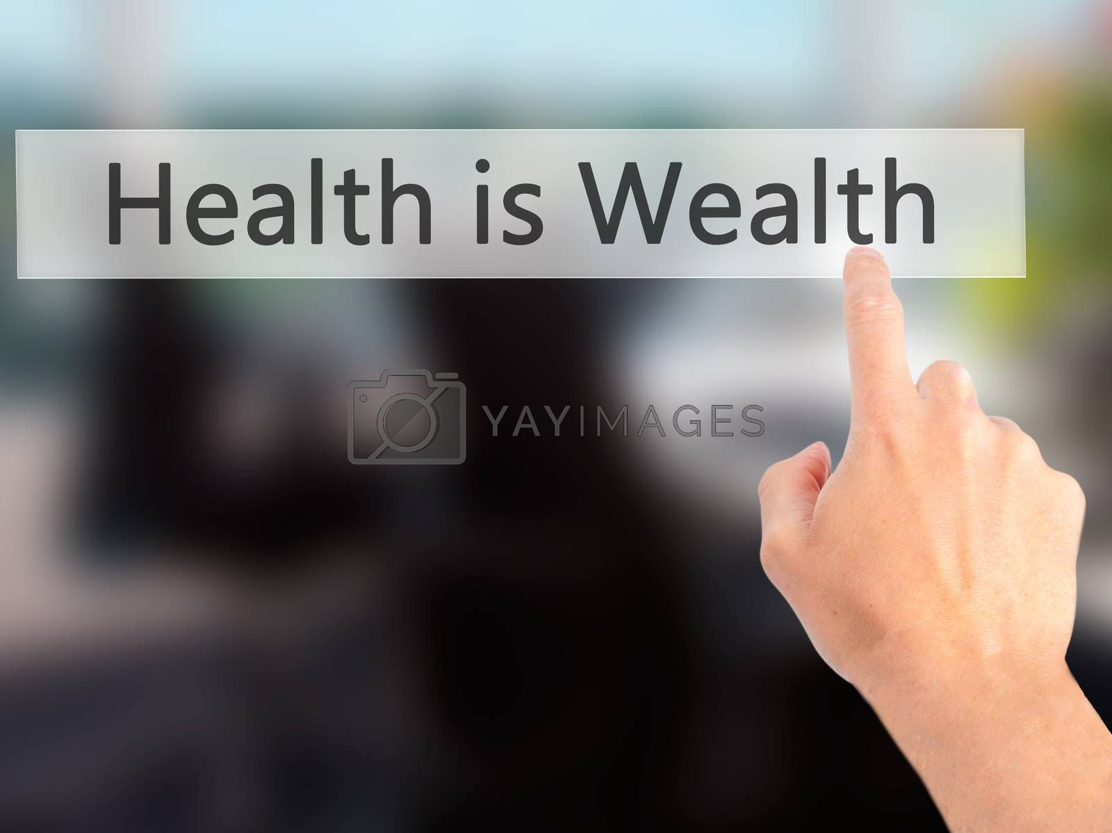 Health is Wealth - Hand pressing a button on blurred background  by netsay.net