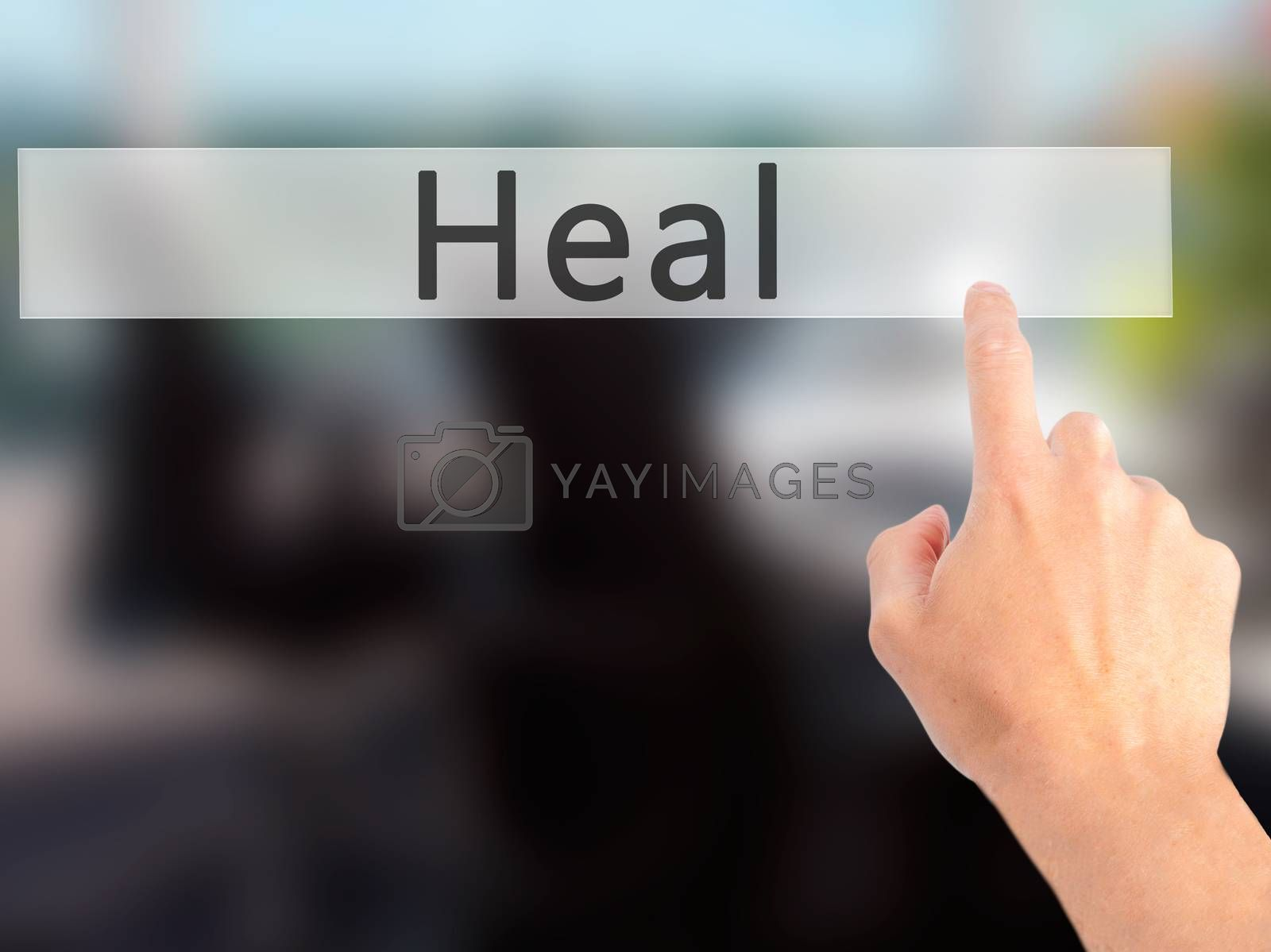 Heal - Hand pressing a button on blurred background concept on v by netsay.net