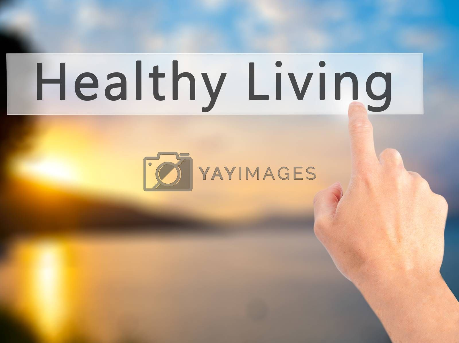 Healthy Living - Hand pressing a button on blurred background co by netsay.net