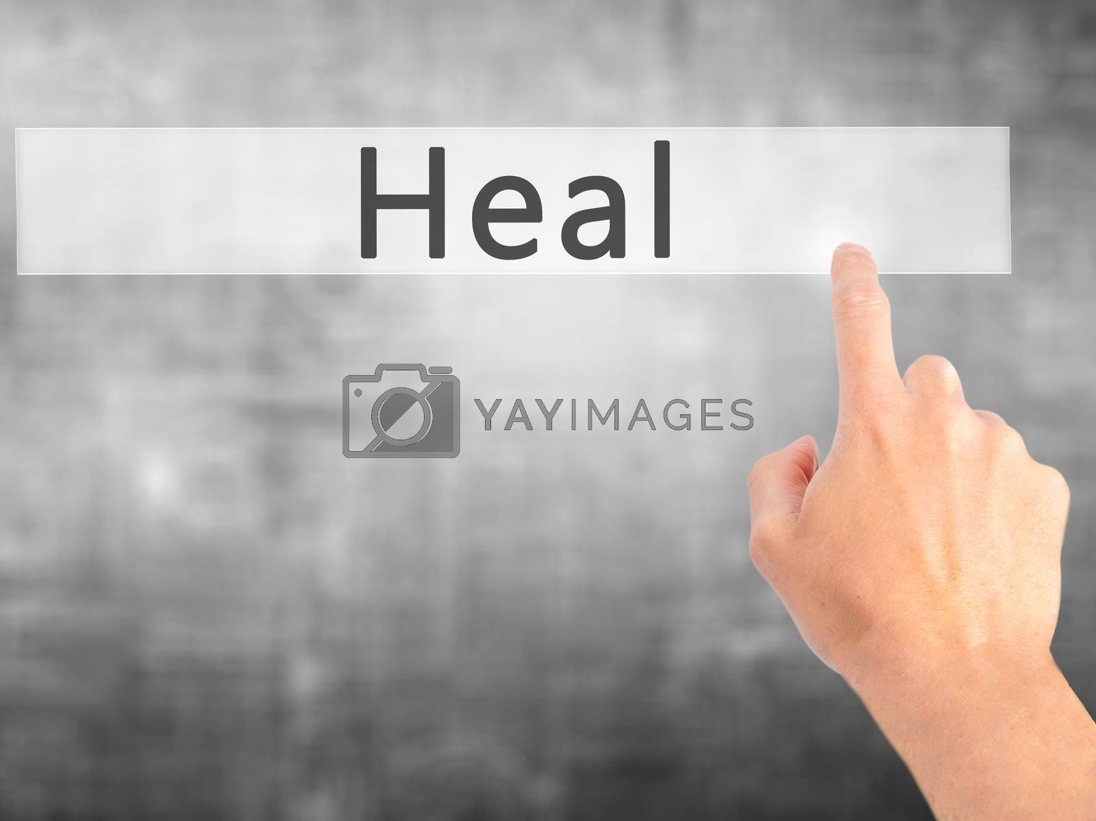 Heal - Hand pressing a button on blurred background concept on v by jackald