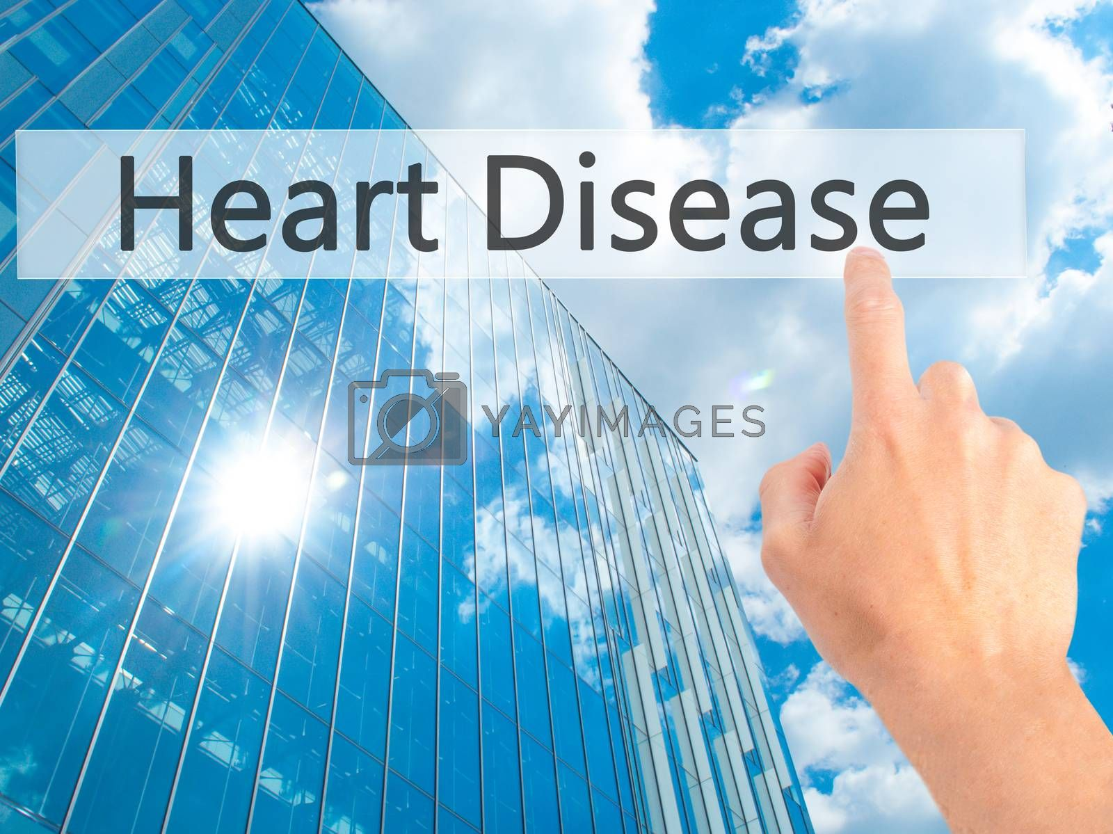 Heart Disease - Hand pressing a button on blurred background con by jackald